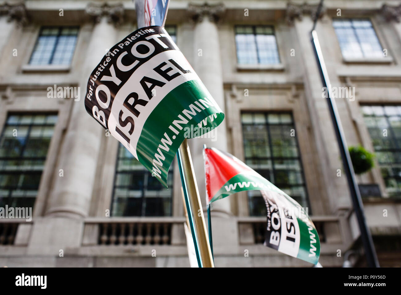 'Boycott Israel' flags are held overhead during the annual pro-Palestine/anti-Israel Al Quds Day demonstration in central London. The demonstration is notably controversial in the city for the flying of Hizbullah flags that typically takes place during the course of it. - Stock Image