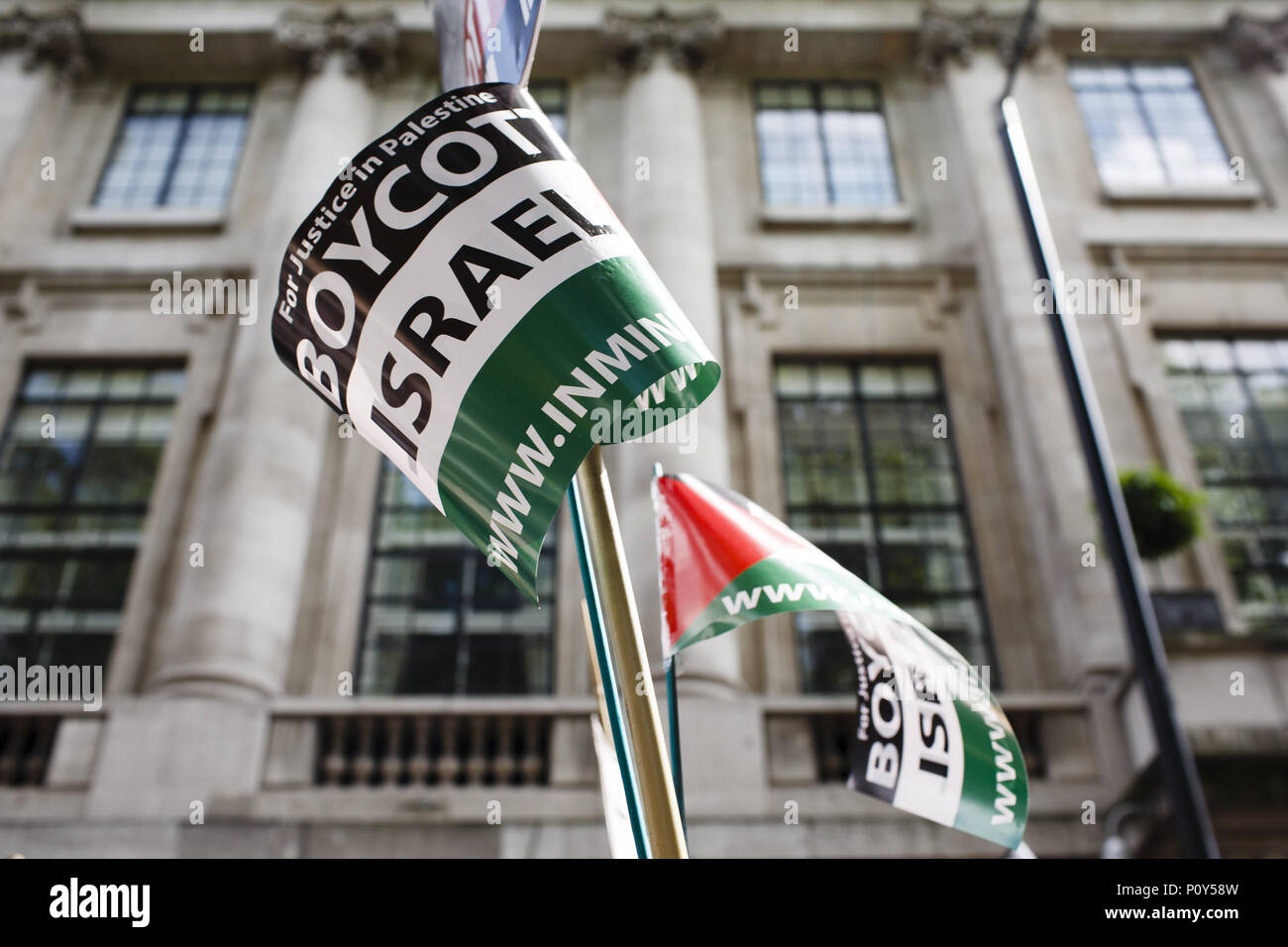London, UK. 10th June, 2018. 'Boycott Israel' flags are held overhead during the annual pro-Palestine/anti-Israel Al Quds Day demonstration in central London. The demonstration is notably controversial in the city for the flying of Hizbullah flags that typically takes place during the course of it. Credit: David Cliff/SOPA Images/ZUMA Wire/Alamy Live News - Stock Image