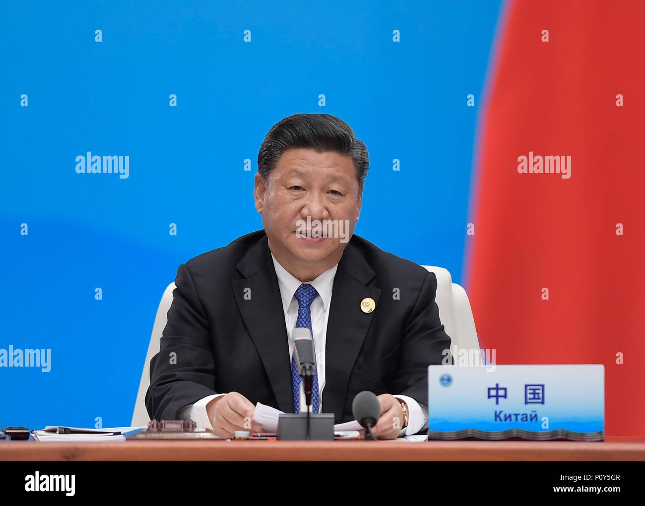 Qingdao, China's Shandong Province. 10th June, 2018. Chinese President Xi Jinping chairs the 18th Meeting of the Council of Heads of Member States of the Shanghai Cooperation Organization (SCO) in Qingdao, east China's Shandong Province, June 10, 2018. Xi delivered a speech during the meeting. Credit: Li Xueren/Xinhua/Alamy Live News - Stock Image