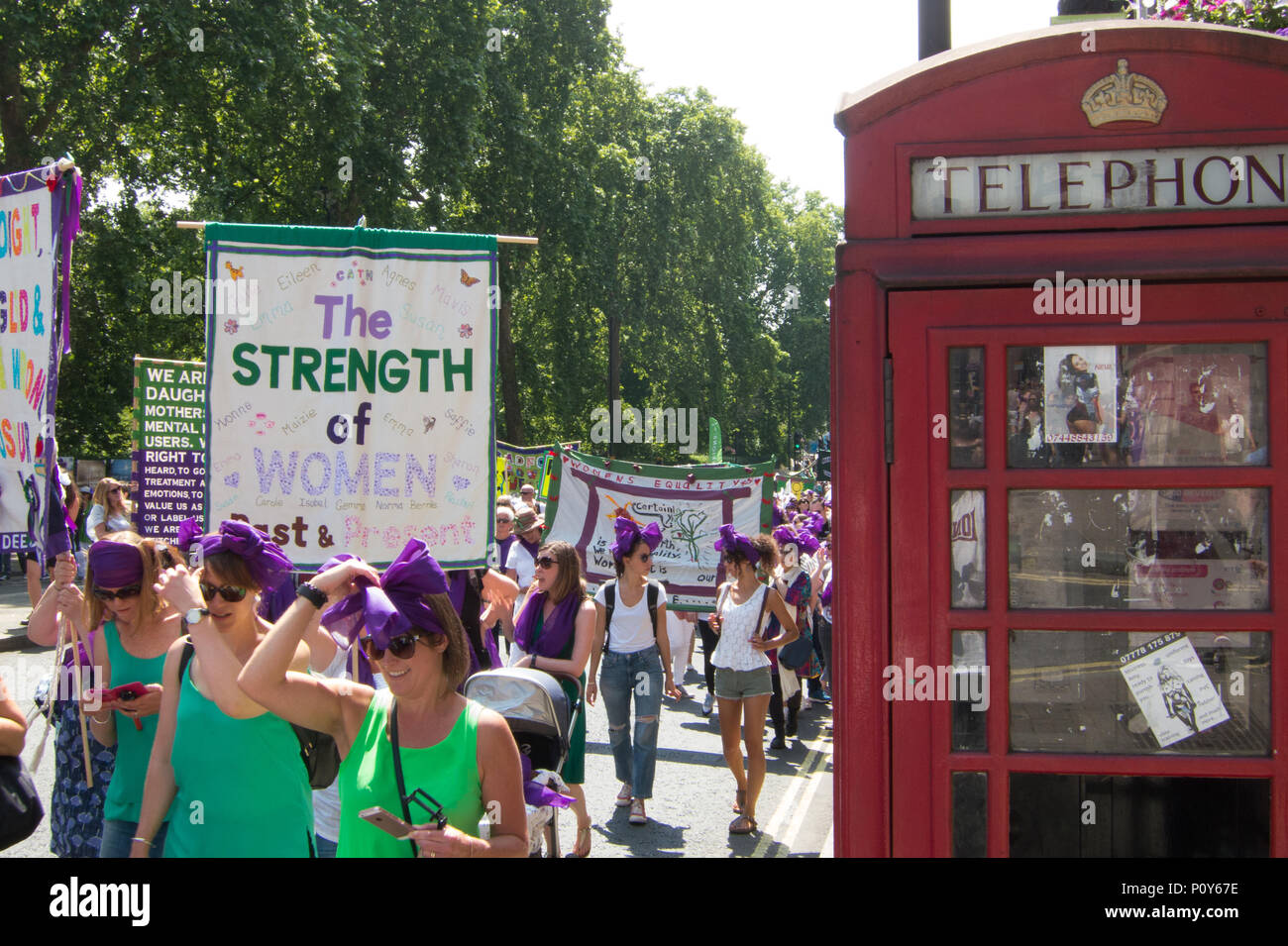 london procession celebrating 100 years of women having the vote with the juxtaposition of calling cards in a public phone box for what some would call the - Payphone Calling Cards