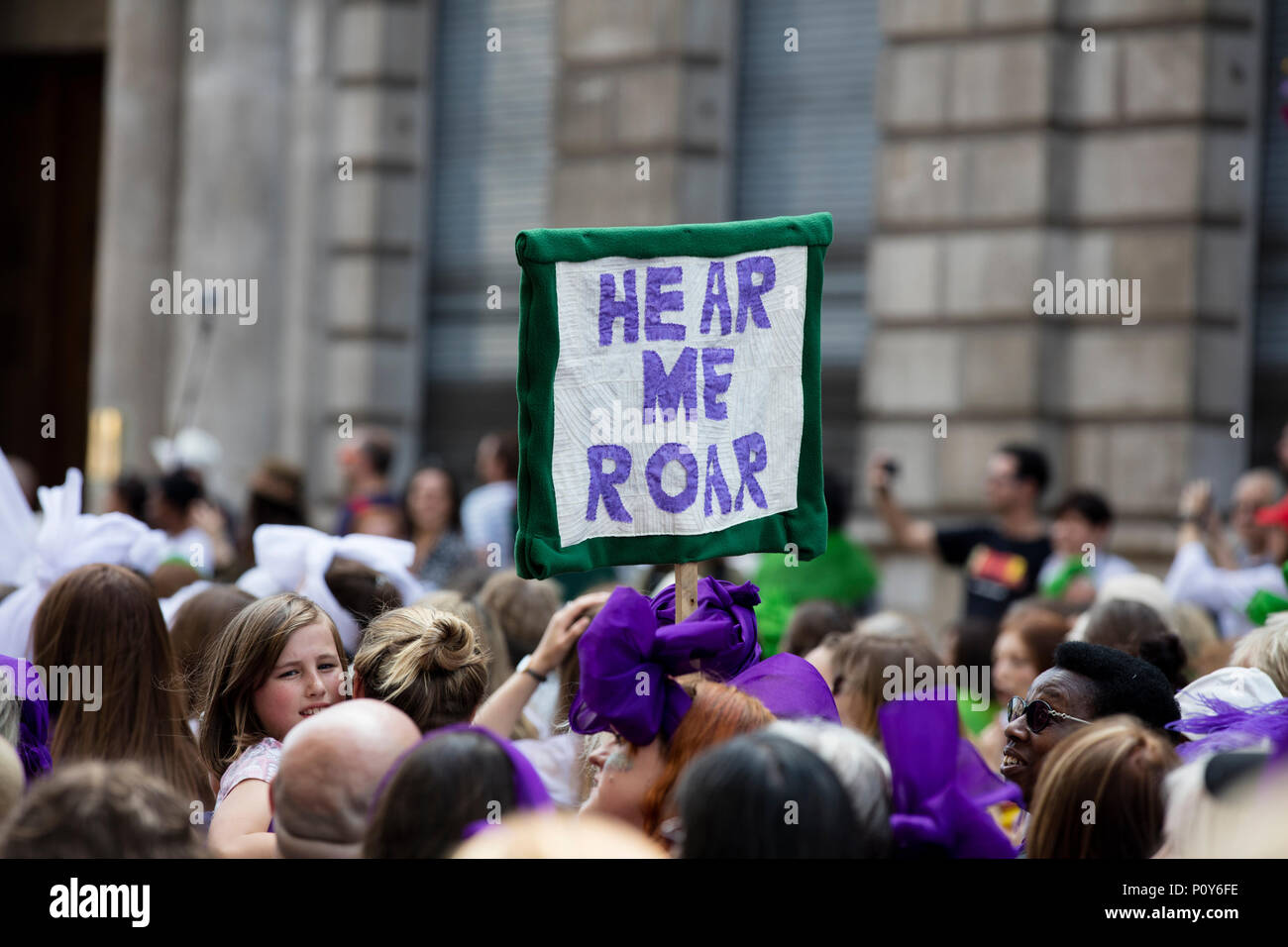 Thousands of woman and girls march in London celebrating 100 years of the women's vote and gender equality, organised by 14-18 Now and artichoke. Credit: Ink Drop/Alamy Live News - Stock Image