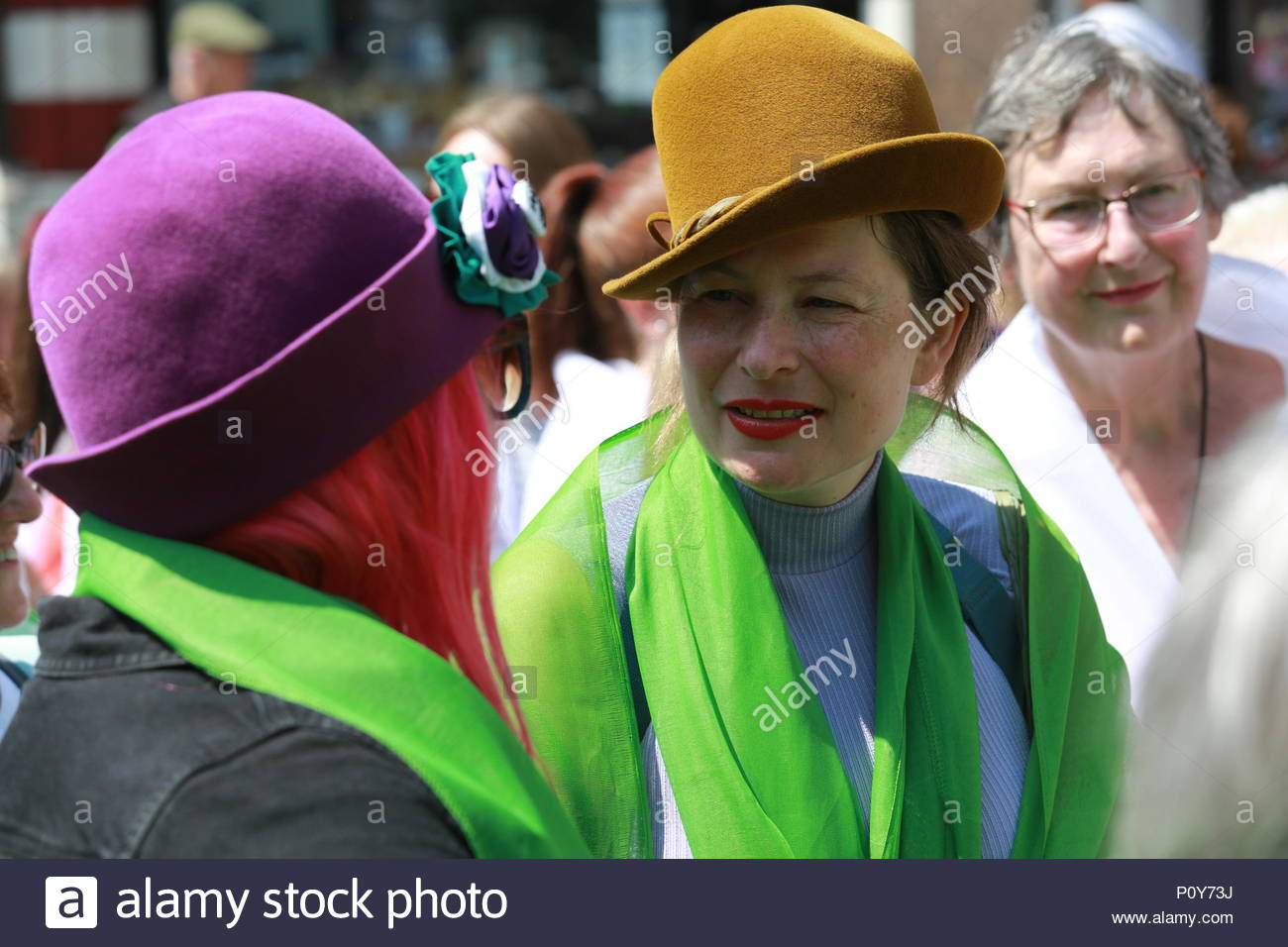 London, UK. 10th June 2018. Glorious weather in London as a march to Westminster took place in honour of the Suffragette movement. A large march wound its way towards Westminster with thousands of jubilant women celebrating 100 years of votes for women. Stock Photo