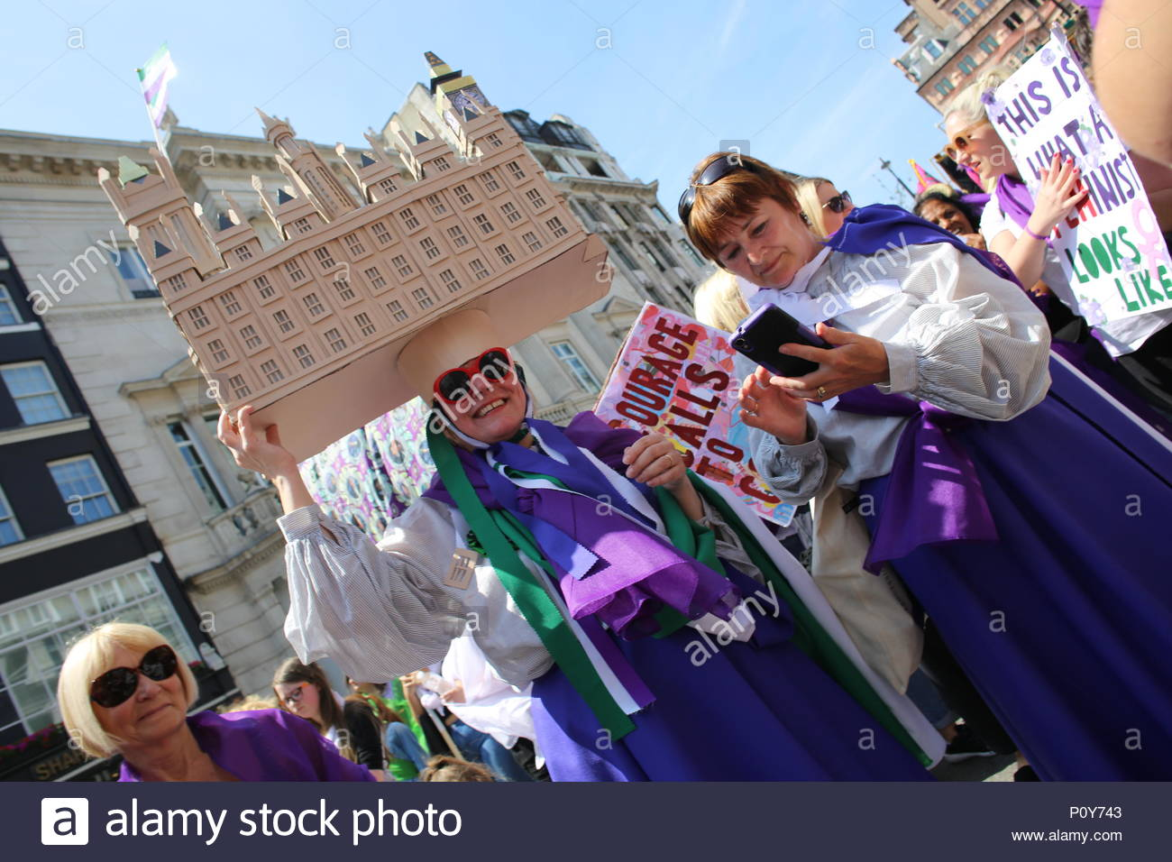 London, UK. 10th June 2018. Glorious weather in London as a march to Westminster took place in honour of the Suffragette movement. A large march wound its way towards Westminster with thousands of jubilant women celebrating 100 years of votes for women. - Stock Image
