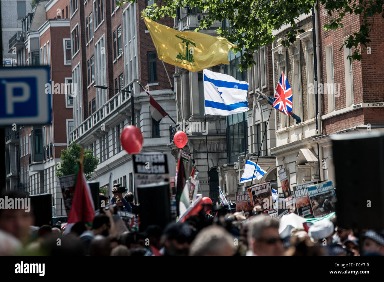 A Hezbollah flag in front the pro-zionist counter-demo.  Hundreds of anti-Israel protesters marched through the streets on the annual Al Quds Day. Started by the Ayatollah Khomeini in 1979 to show support for Palestine and oppose the existence of Israel and the counter protest from the Zionist Federation. - Stock Image