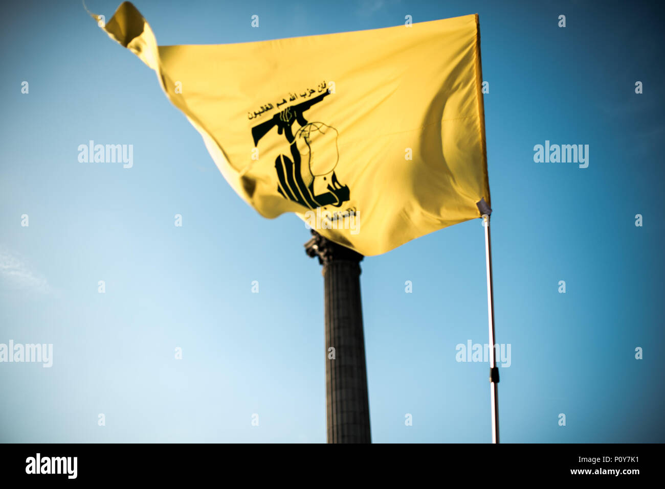 A Hezbollah flag seen in Trafalgar Square during the demonstration.  Hundreds of anti-Israel protesters marched through the streets on the annual Al Quds Day. Started by the Ayatollah Khomeini in 1979 to show support for Palestine and oppose the existence of Israel and the counter protest from the Zionist Federation. - Stock Image
