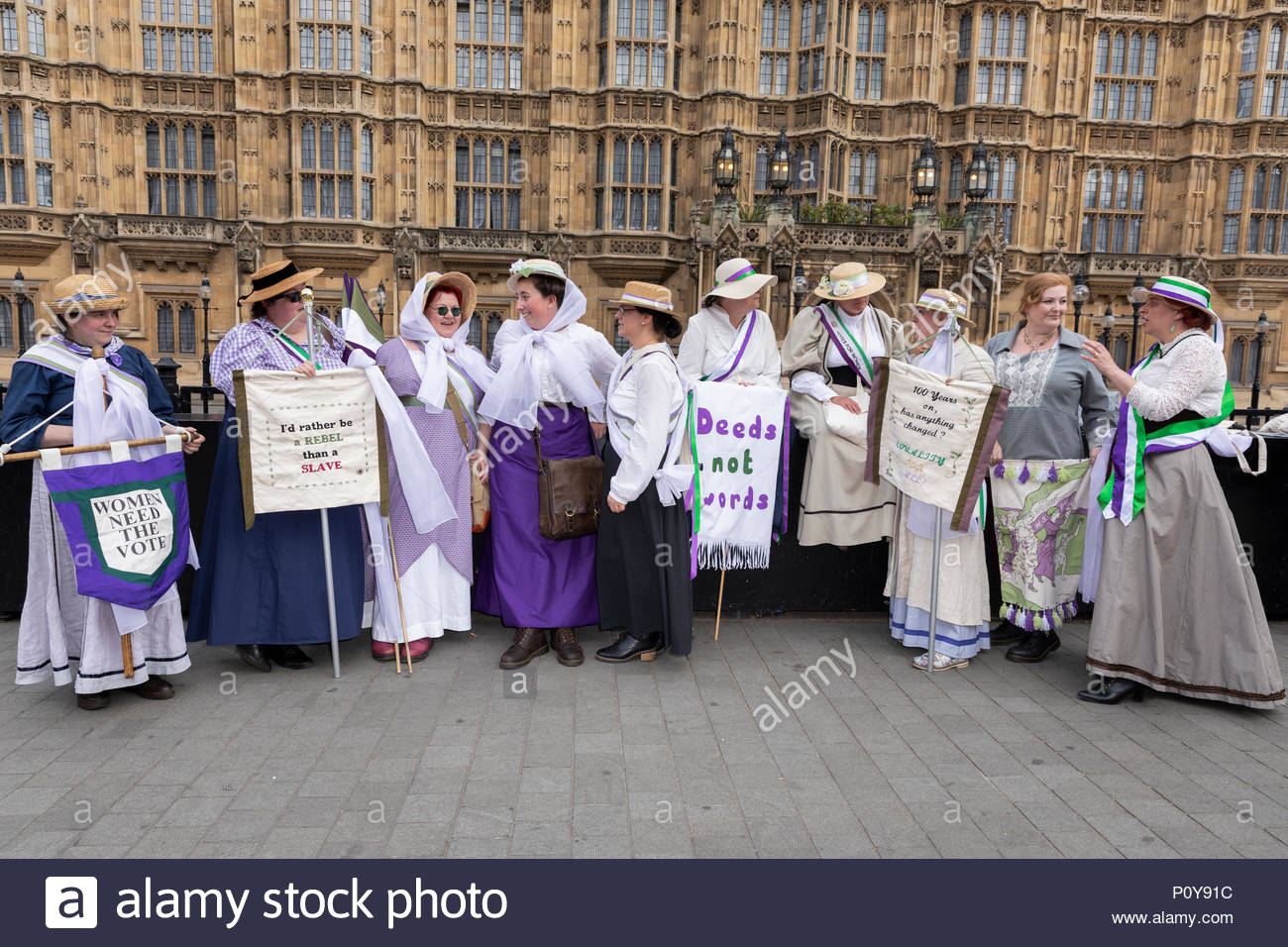 Campaigner for women's rights in procession celebrating 100 years of the women's vote. - Stock Image