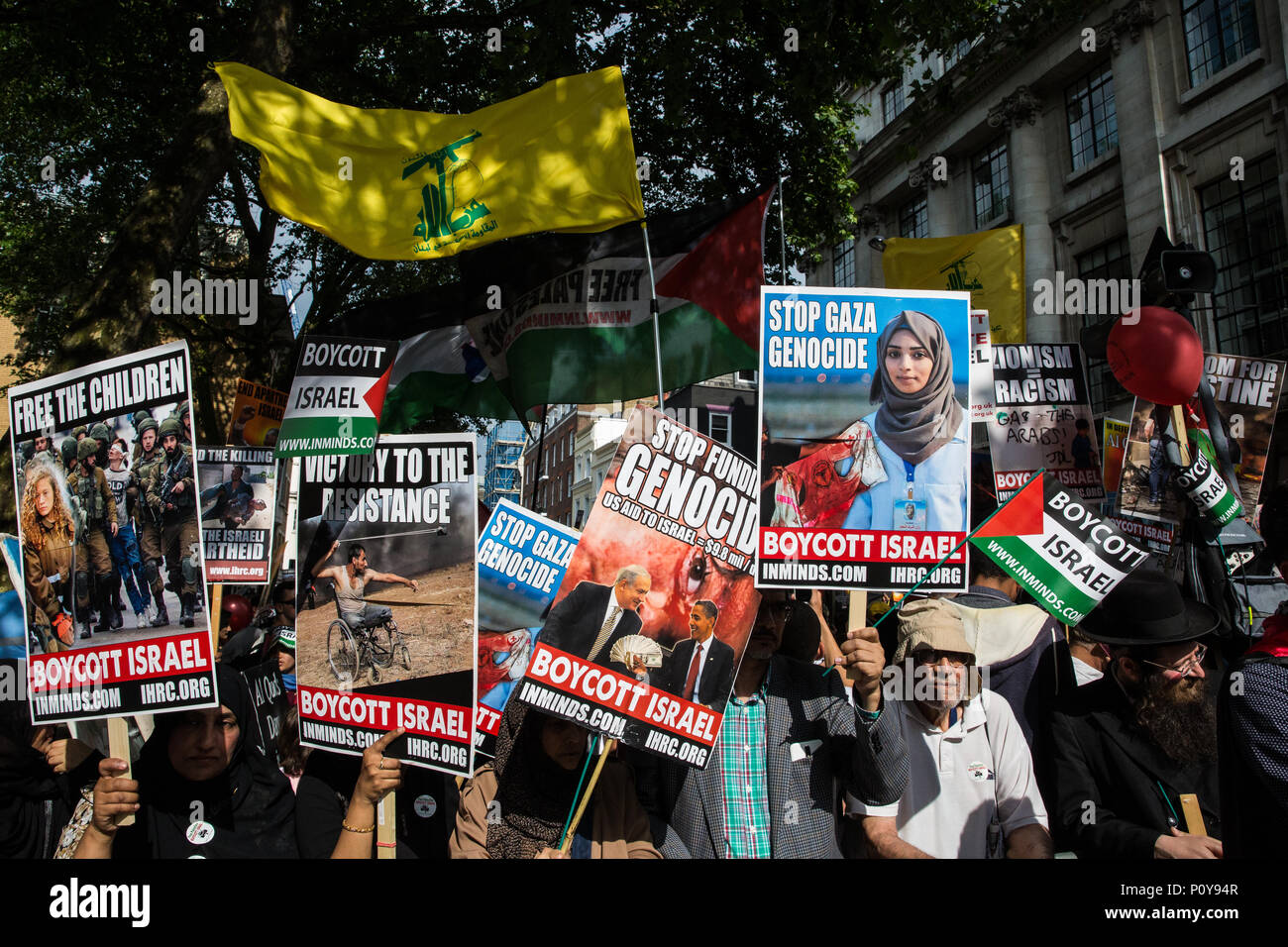 London, UK. 10th June, 2018. Hundreds of people wait with placards and Hezbollah flags outside the Saudi embassy to take part in the pro-Palestinian Al Quds Day march through central London organised by the Islamic Human Rights Commission. An international event, it began in Iran in 1979. Quds is the Arabic name for Jerusalem. Credit: Mark Kerrison/Alamy Live News - Stock Image