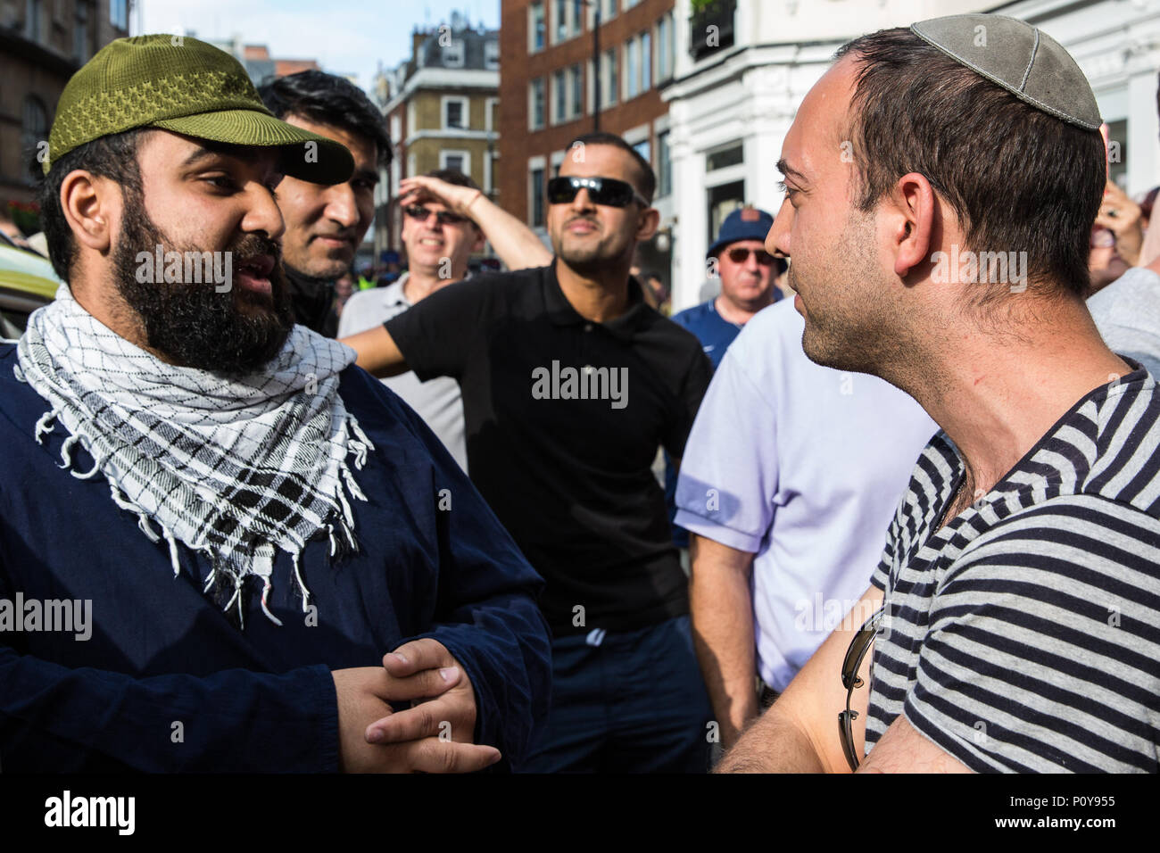 London, UK. 10th June, 2018. Pro-Palestinian and pro-Israel activists debate in the street before the pro-Palestinian Al Quds Day march through central London organised by the Islamic Human Rights Commission. An international event, it began in Iran in 1979. Quds is the Arabic name for Jerusalem. Credit: Mark Kerrison/Alamy Live News - Stock Image