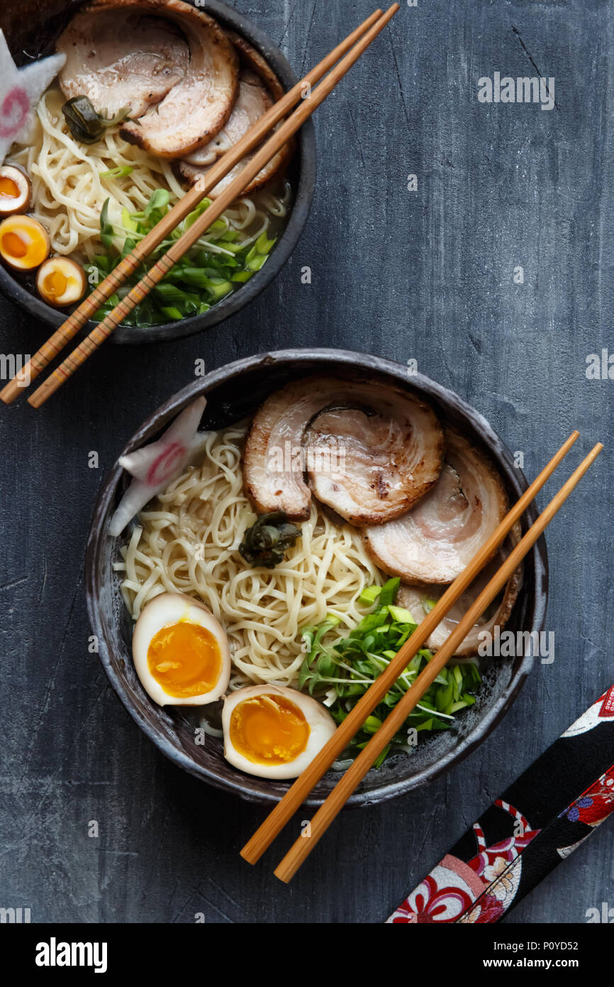 Japanese ramen soup with pork, egg and chives - Stock Image