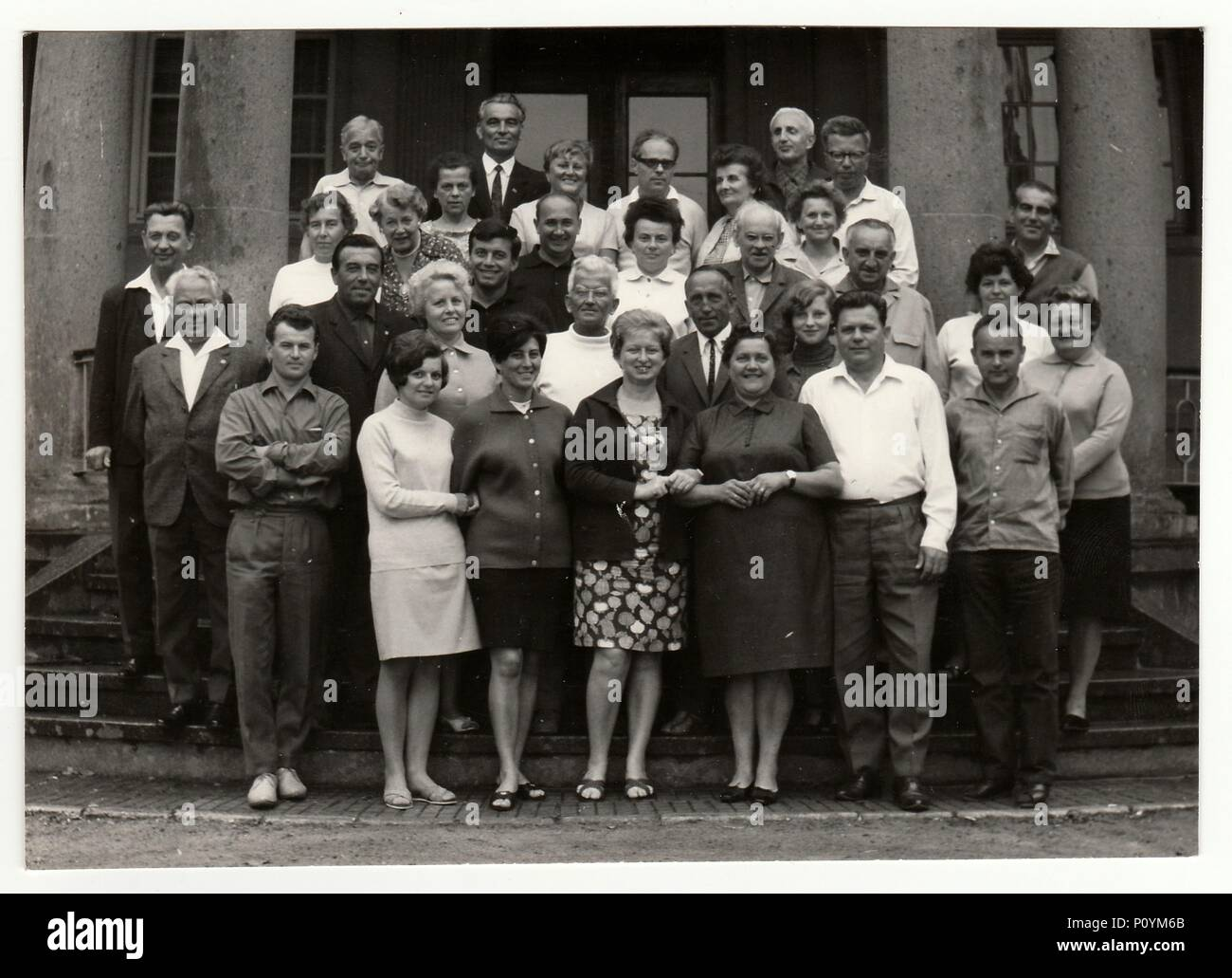 THE CZECHOSLOVAK SOCIALIST REPUBLIC, CIRCA 1970s: Vintage photo shows group of people in front of building, circa 1970s. Stock Photo