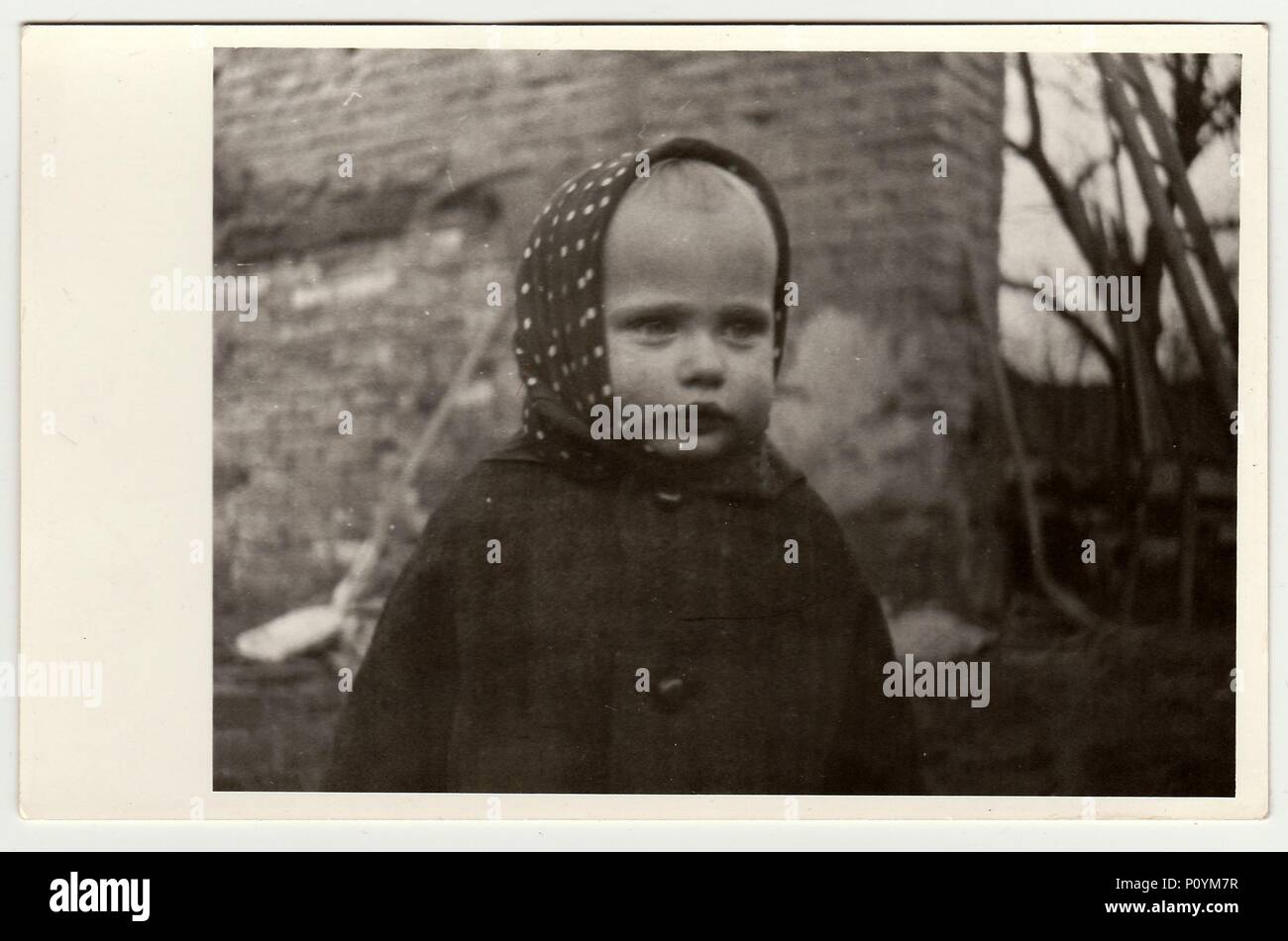THE CZECHOSLOVAK REPUBLIC, CIRCA 1942: Vintage photo shows a small girl wears bandanna, circa 1942. Stock Photo