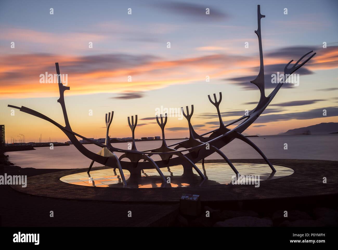 Reyklavik, Iceland - July 28, 2017:  Modern Metal Sculpture Resembling to a Viking Long Ship, The Sun Voyager in Reykjavik Harbor, Iceland - Stock Image