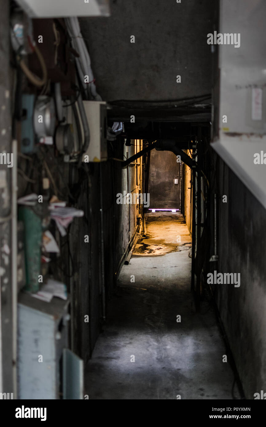 Small dark, creepy and claustrophobic hallway in Taipei - Stock Image