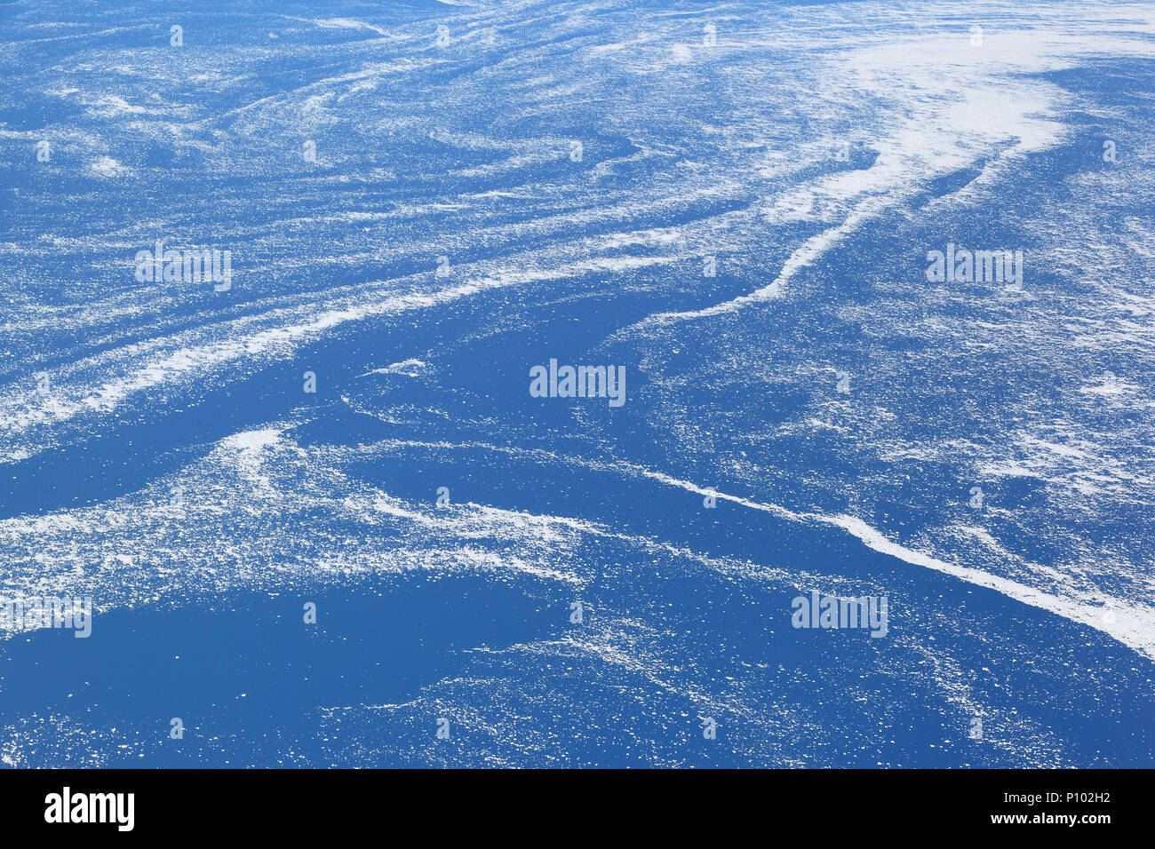 Aerial view of floating sea ice caught in marine currents off the eastern coast of Canada. - Stock Image