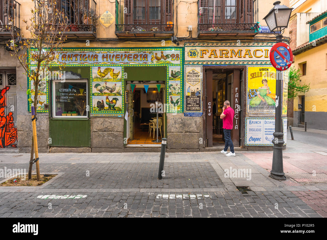 Madrid bar, view of a bar in the Malasana district of Madrid which has retained the original azulejo tiles and signs of a former local pharmacy. - Stock Image