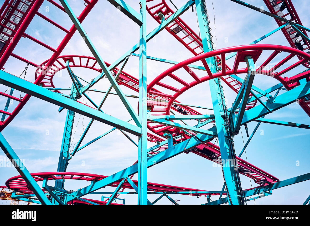 Roller coaster tracks in an amusement park, color toning applied. - Stock Image