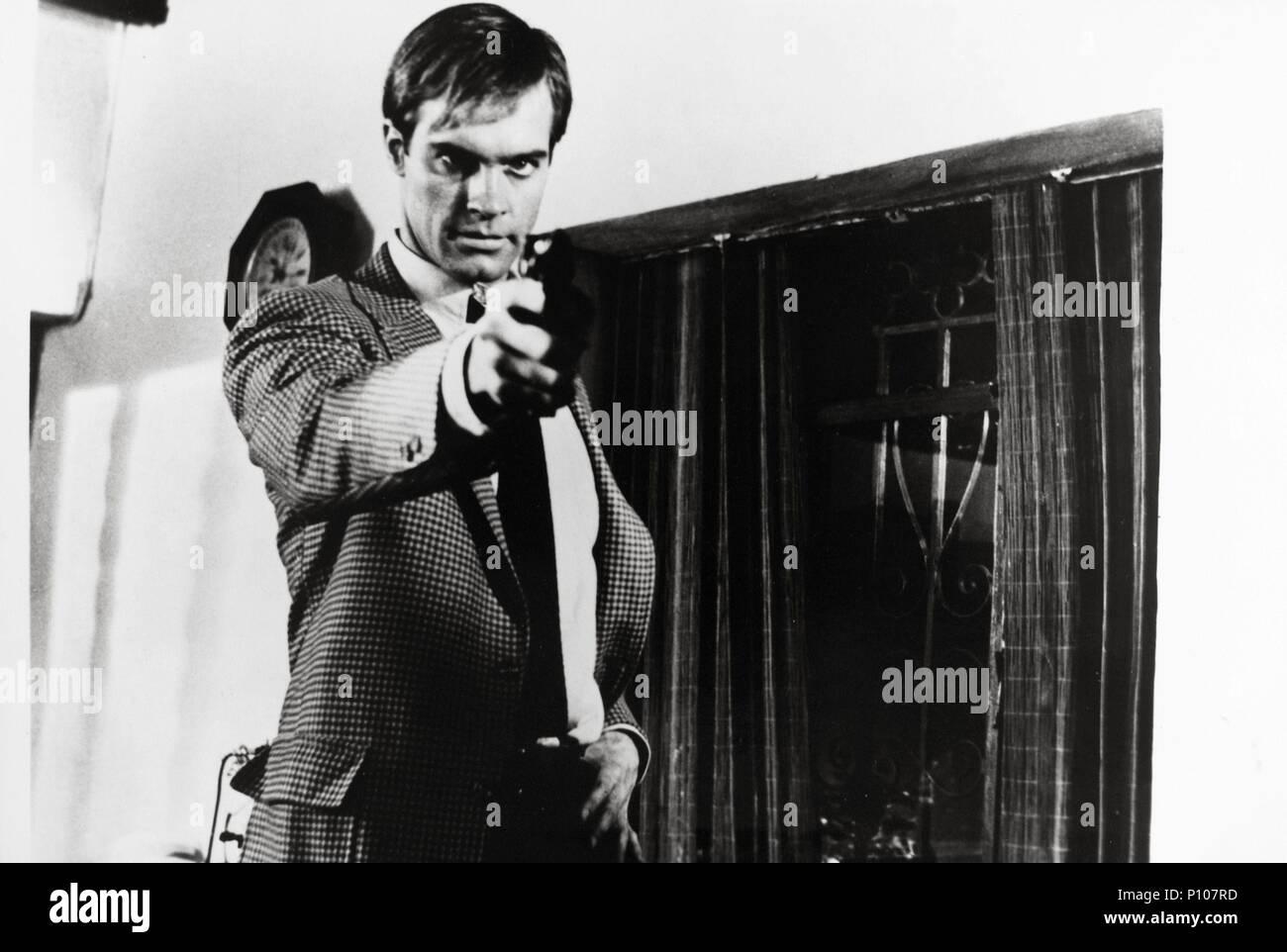 Original Film Title: THE RHINEMANN EXCHANGE.  English Title: THE RHINEMANN EXCHANGE.  Film Director: BURT KENNEDY.  Year: 1977.  Stars: STEPHEN COLLINS. - Stock Image