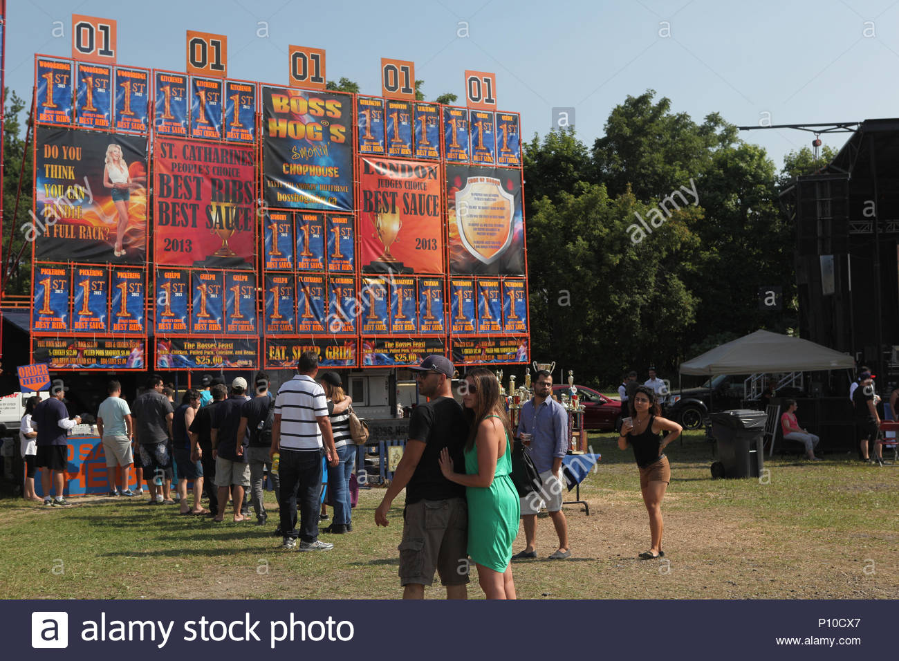 Woodbridge, Ontario, Canada.  August 2014 --- Vendors set up giant advertising boards above their cooking area to attract visitors during the Woodbrid - Stock Image