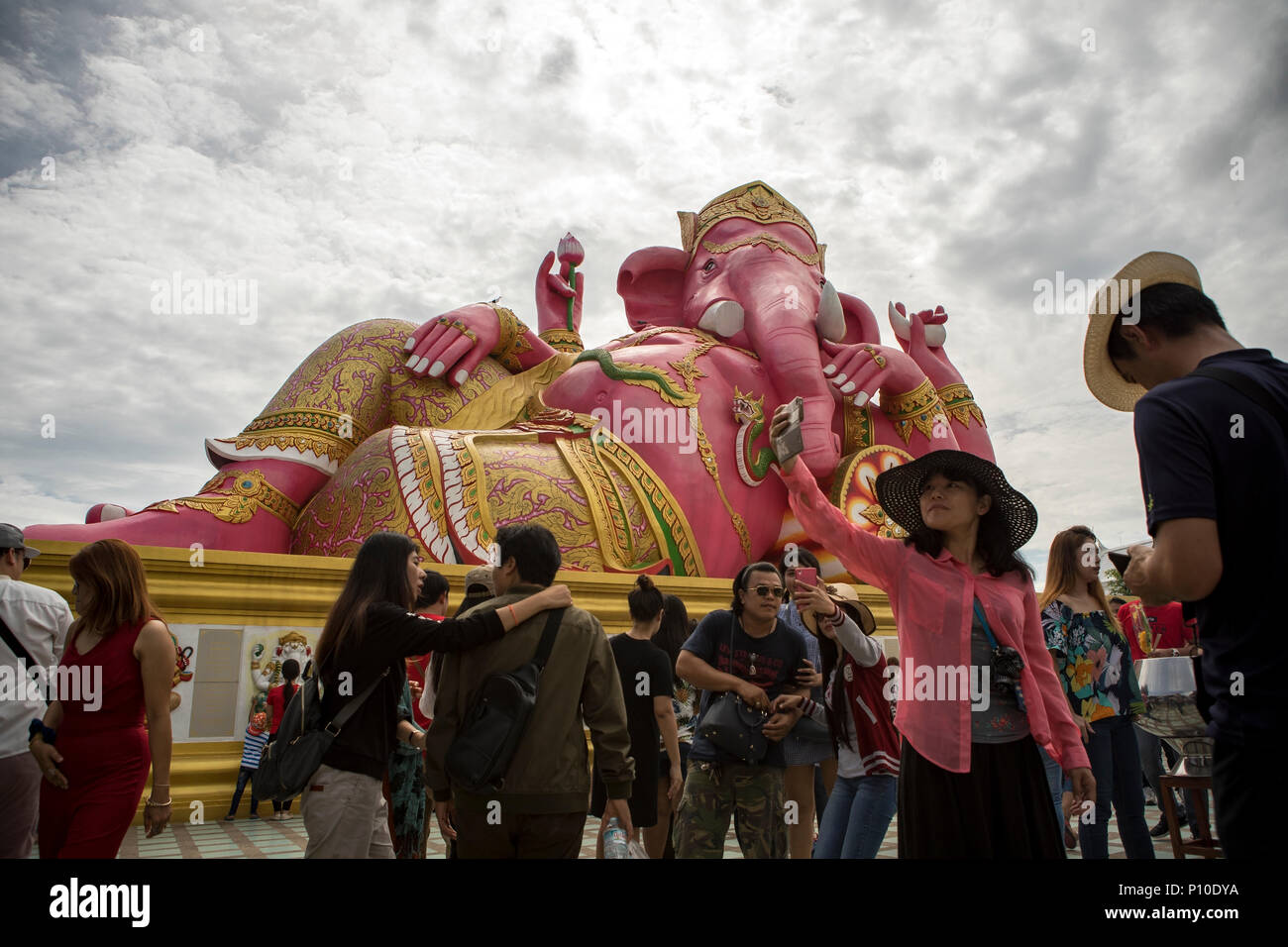 CHACHOENGSAO THAILAND - JUNE10,2018 : large number of tourist taking a photograph in front of pink ganesha statue at wat saman rattanaram most popular - Stock Image