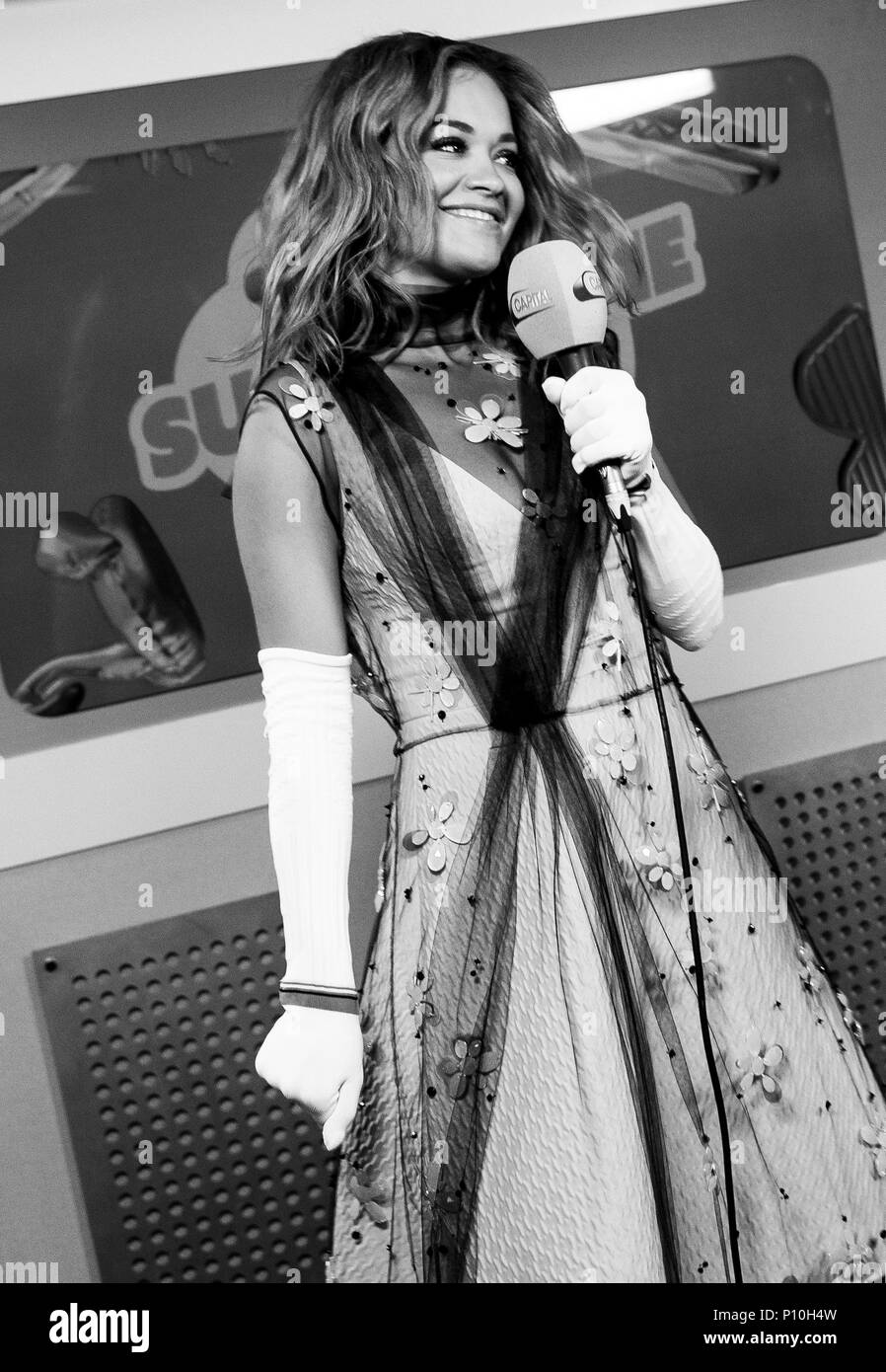 Rita Ora in the on air studio during Capital's Summertime Ball with Vodafone at Wembley Stadium, London. PRESS ASSOCIATION Photo. This summer's hottest artists performed live for 80,000 Capital listeners at Wembley Stadium at the UK's biggest summer party. Performers included Camila Cabello, Shawn Mendes, Rita Ora, Charlie Puth, Jess Glyne, Craig David, Anne-Marie, Rudimental, Sean Paul, Clean Bandit, James Arthur, Sigala, Years & Years, Jax Jones, Raye, Jonas Blue, Mabel, Stefflon Don, Yungen and G-Eazy. Picture date: Saturday June 9, 2018. Photo credit should read: Lauren Hurley/PA Wire - Stock Image