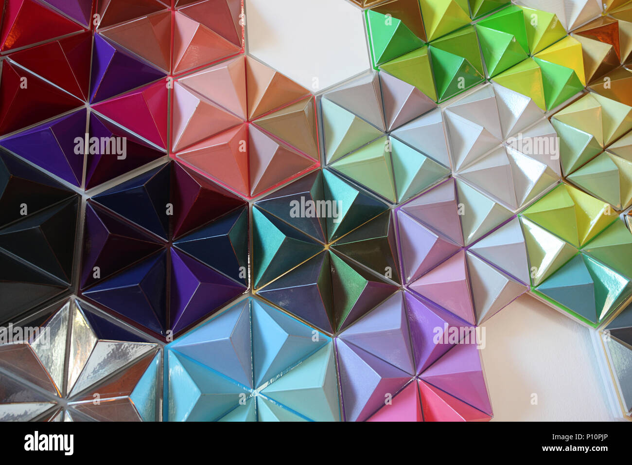 Contemporary 3D wall art of colourful polyhedrons - Stock Image