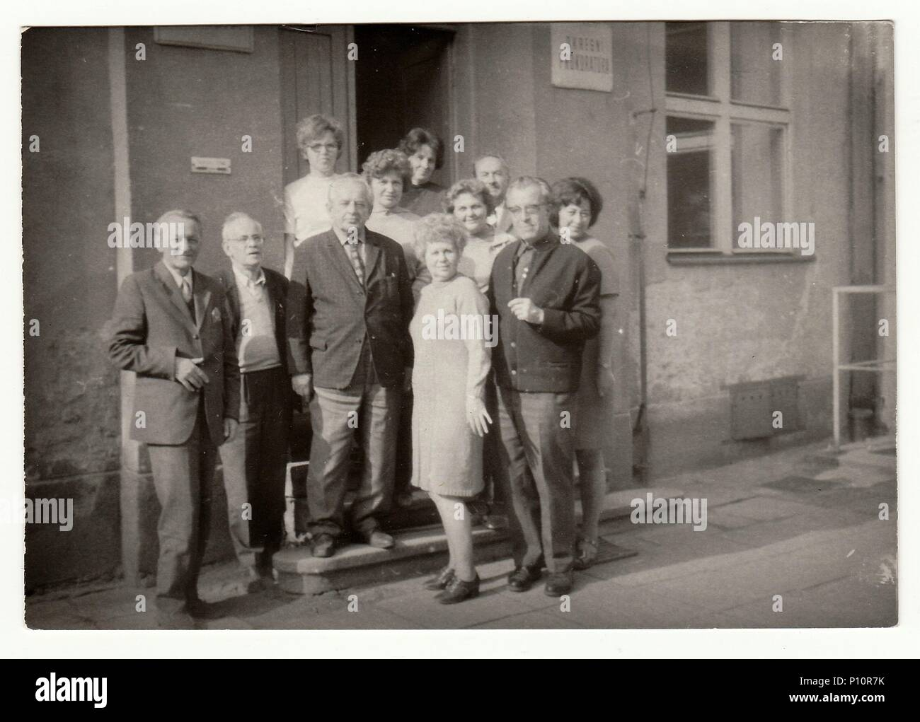 THE CZECHOSLOVAK SOCIALIST REPUBLIC, CIRCA 1970s: Vintage photo shows group of people in front of building. Stock Photo