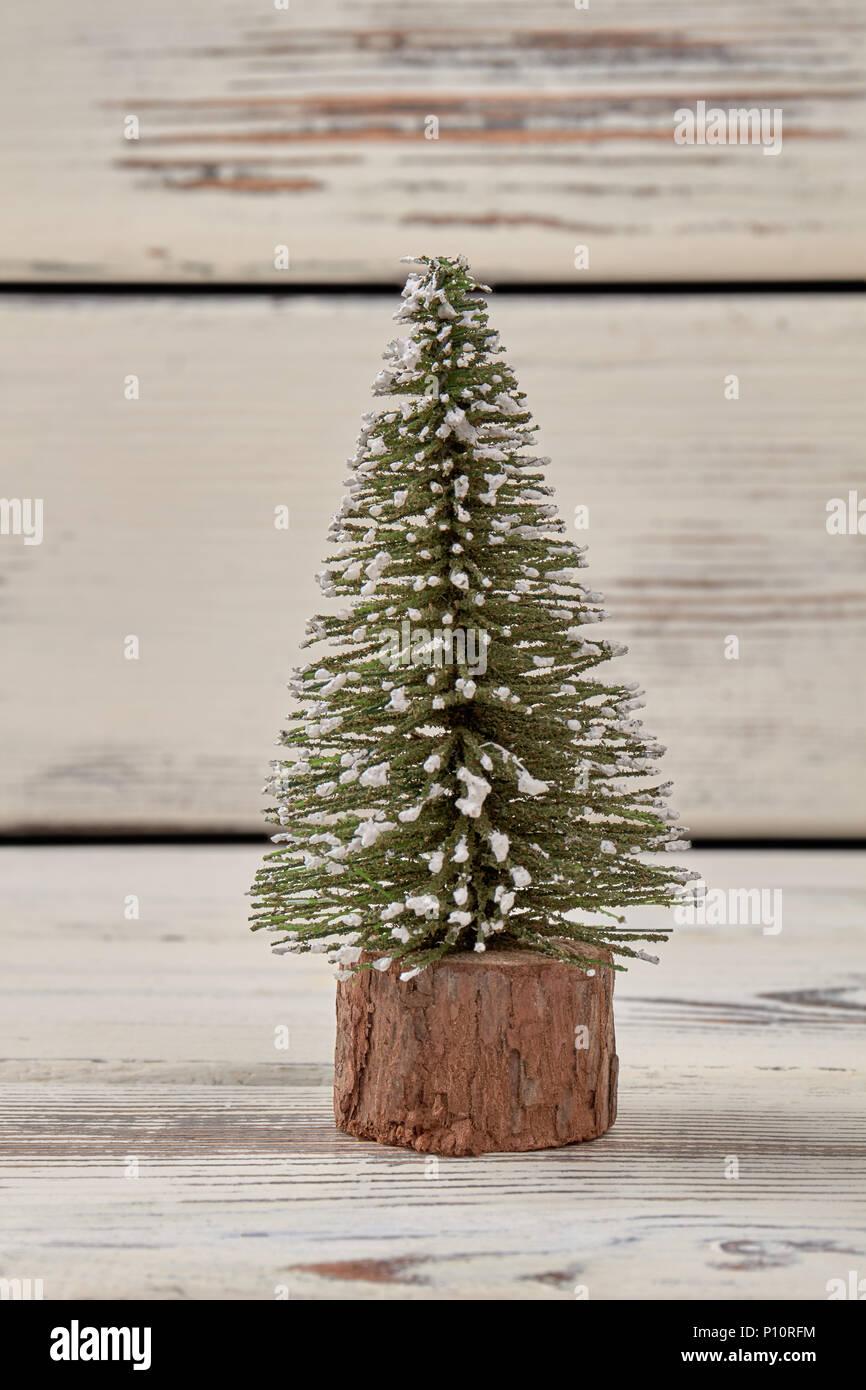 mini christmas tree on wood white wood background - White Mini Christmas Tree