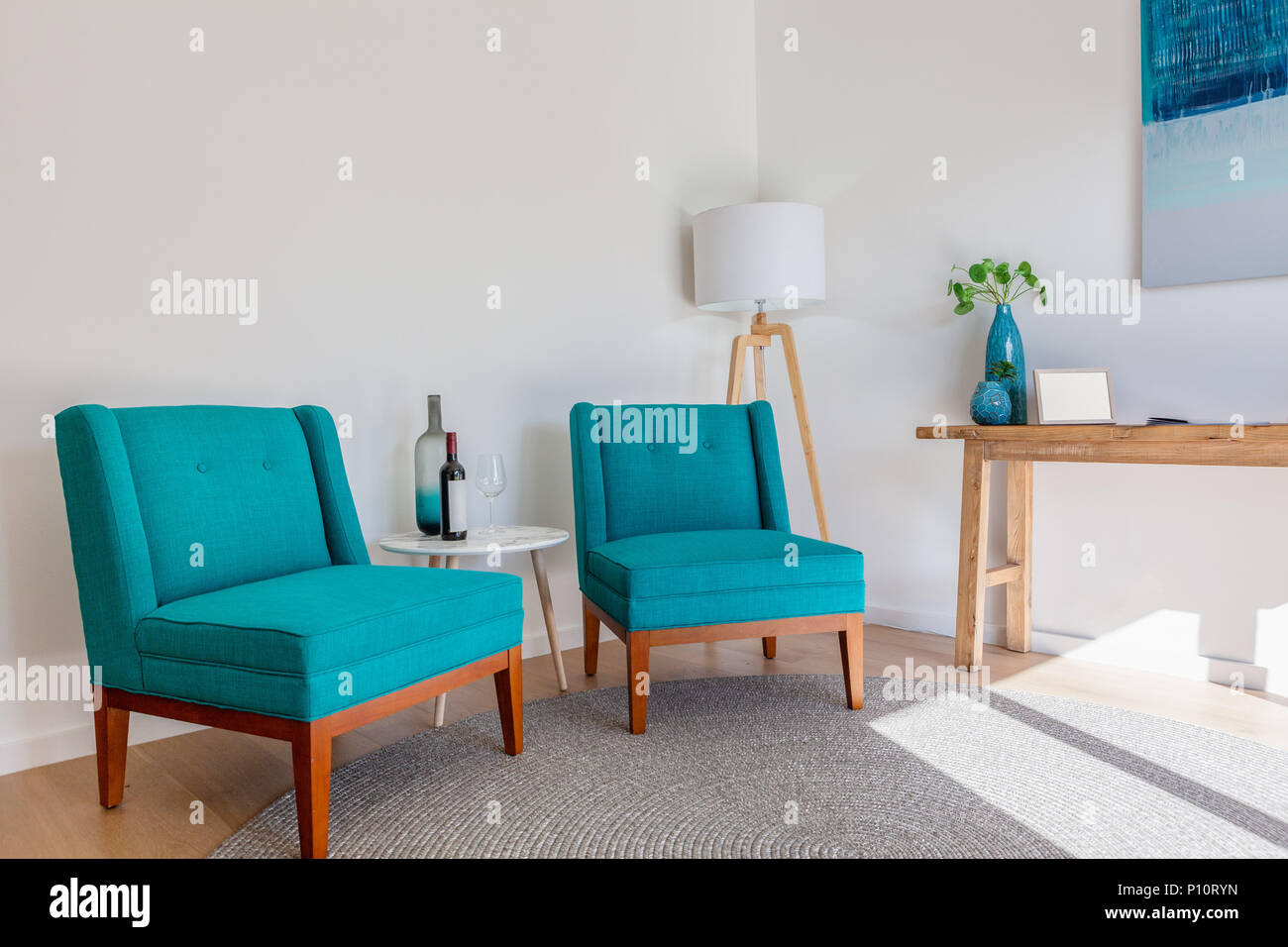 Scandinavian furniture interior with copy space armchairs small tables and lamp under natural sunlight