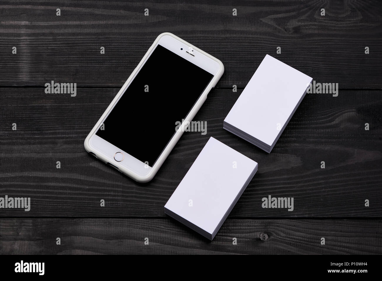 Business card and phone blank mockup stock photos business card mockup of cellphone with blank screen and business cards stock image reheart Images