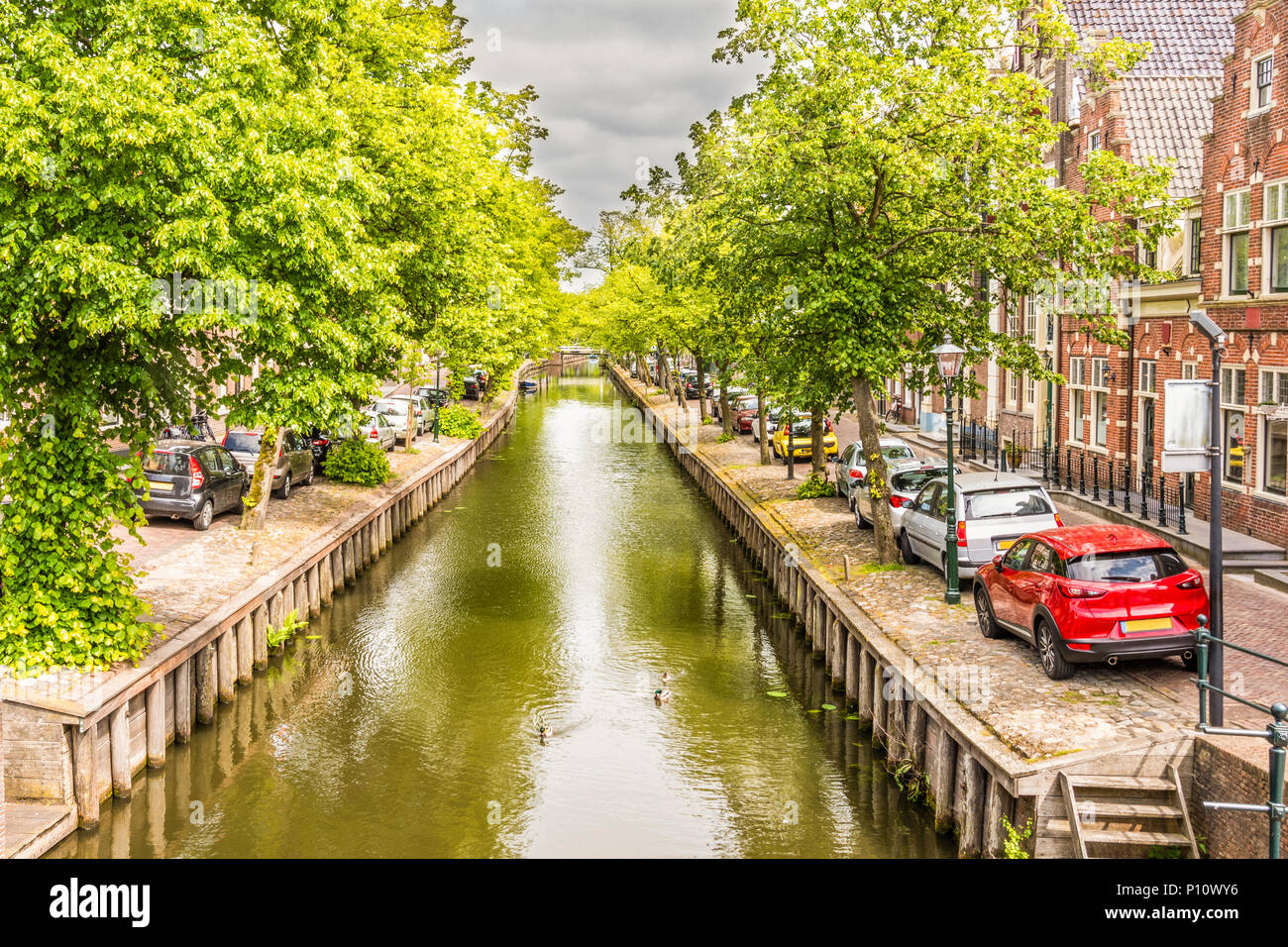 Canal street with its traditional houses and bridges in a neighborhood of la vila de edam. netherlands - Stock Image