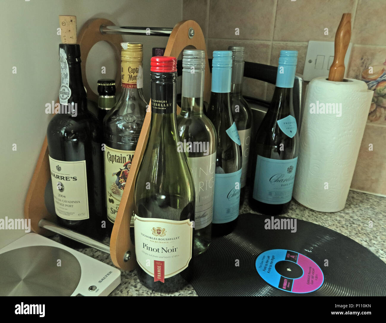Epidemic of drinking too much alcohol at home, wine beer, rum,port - Stock Image