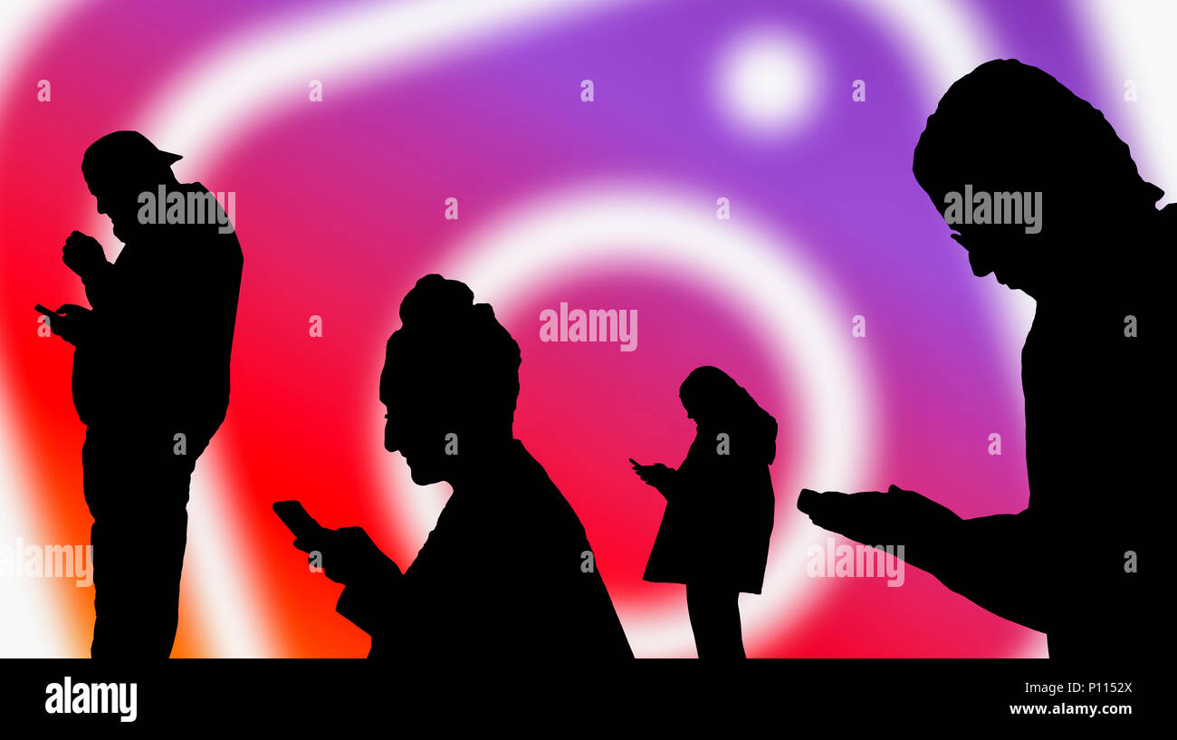 Silhouettes of a group of people posting on the Instagram social media app. - Stock Image