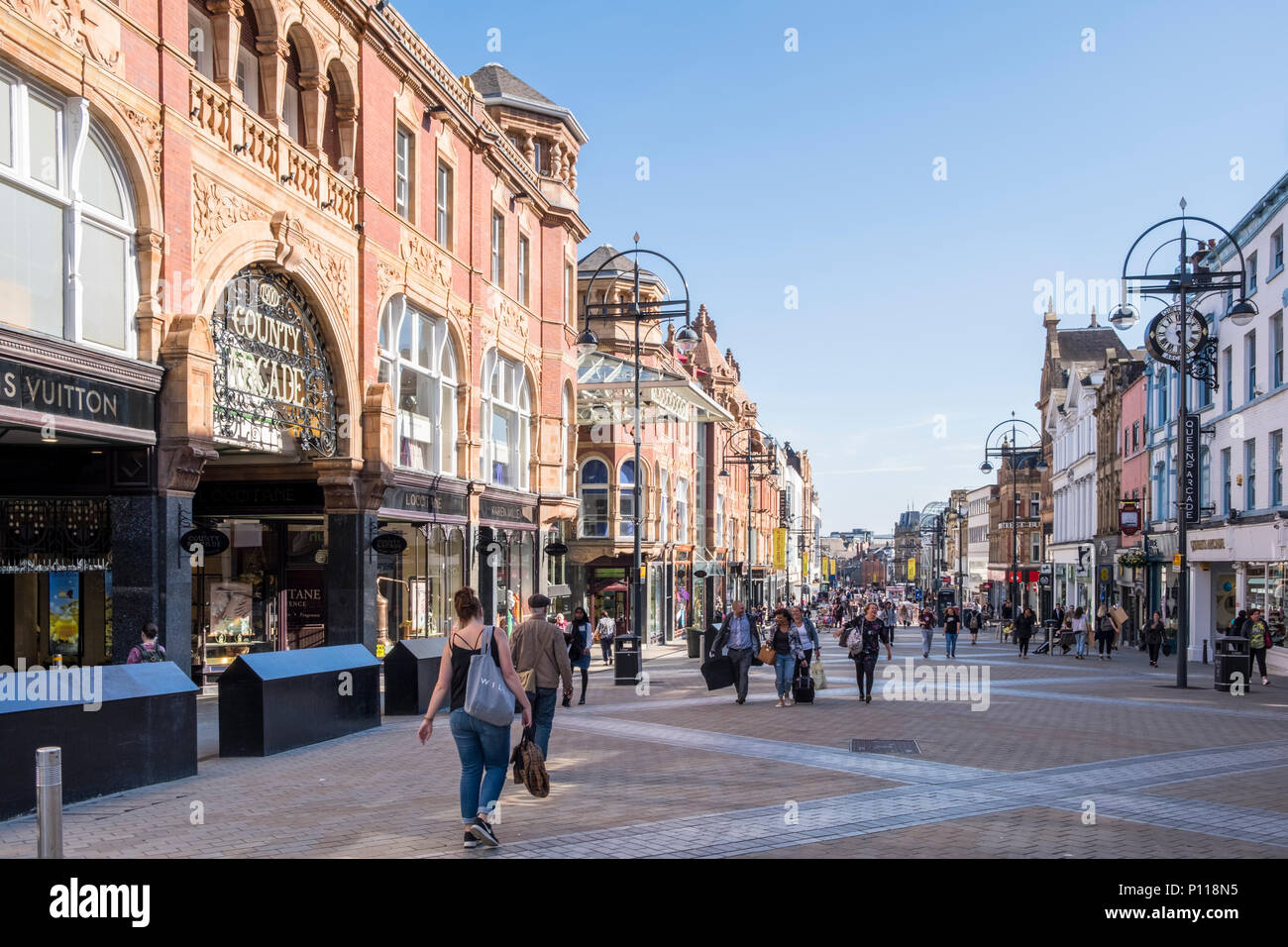 Shoppers on Briggate in the Victoria Quarter of Leeds city centre, West Yorkshire, England, UK - Stock Image