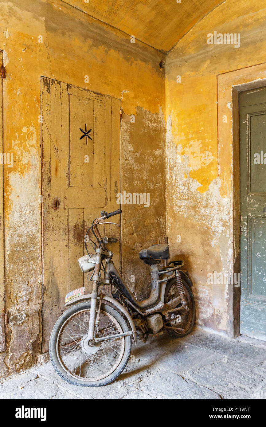 Old Moped in a garage - Stock Image