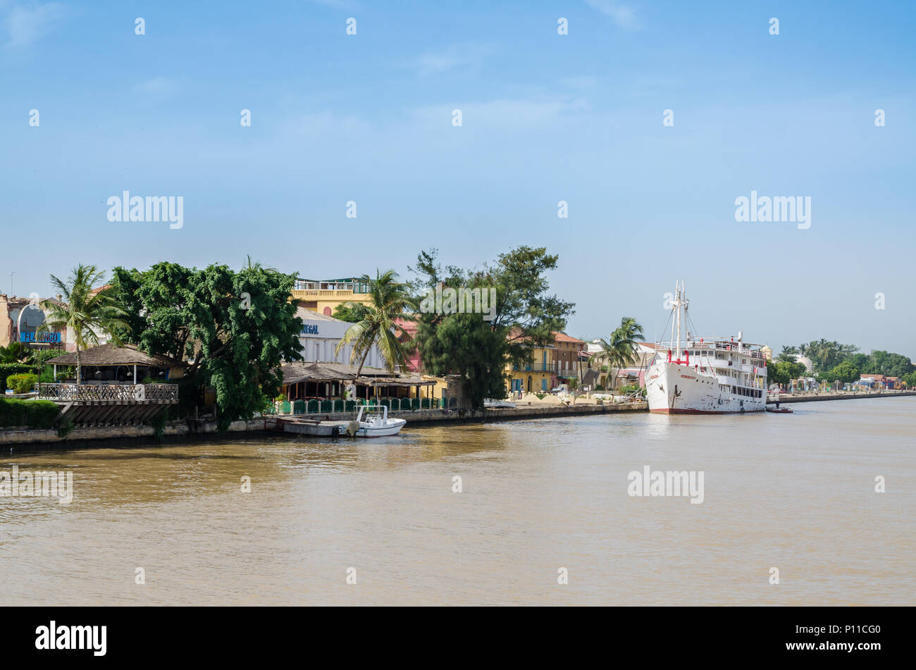 Senegal River with waterfront and historical ship in town Staint-Louis - Stock Image