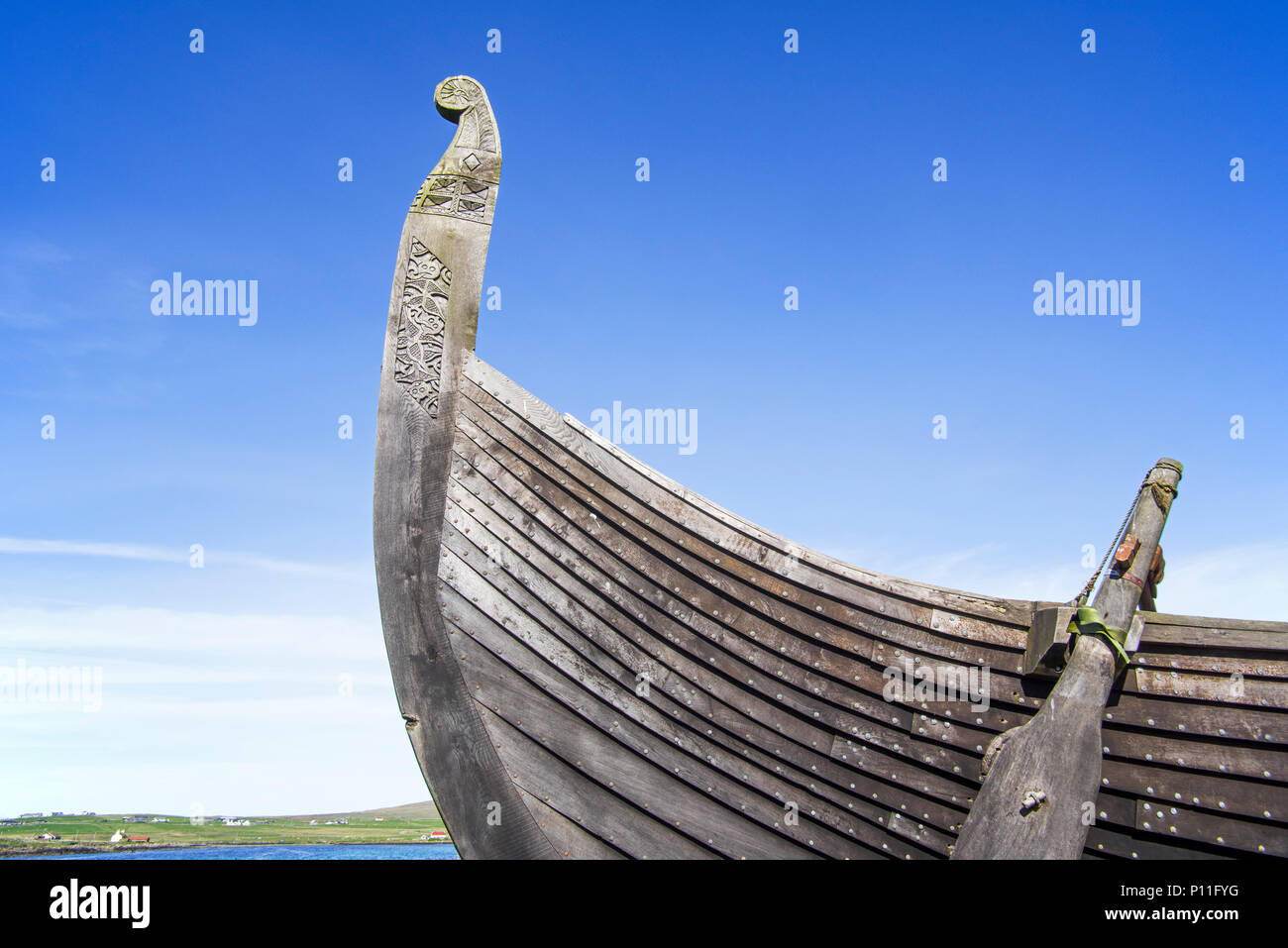 Steering oar at stern of Skidbladner, full size replica of the Gokstad ship at Brookpoint, Unst, Shetland Islands, Scotland, UK - Stock Image
