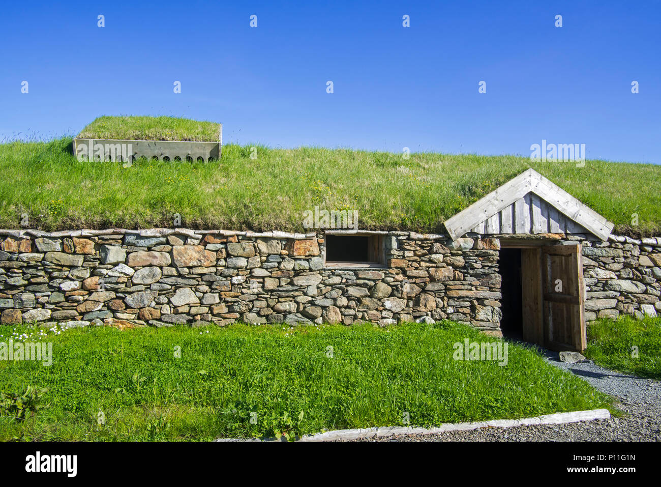 Replica of Norse Viking longhouse at Brookpoint, Unst, Shetland Islands, Scotland, UK - Stock Image