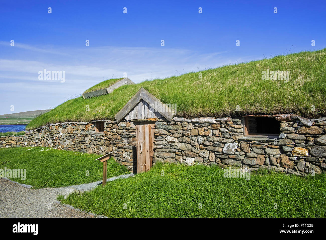 Replica of Norse Viking longhouse at Brookpoint, Unst, Shetland Islands, Scotland, UK Stock Photo