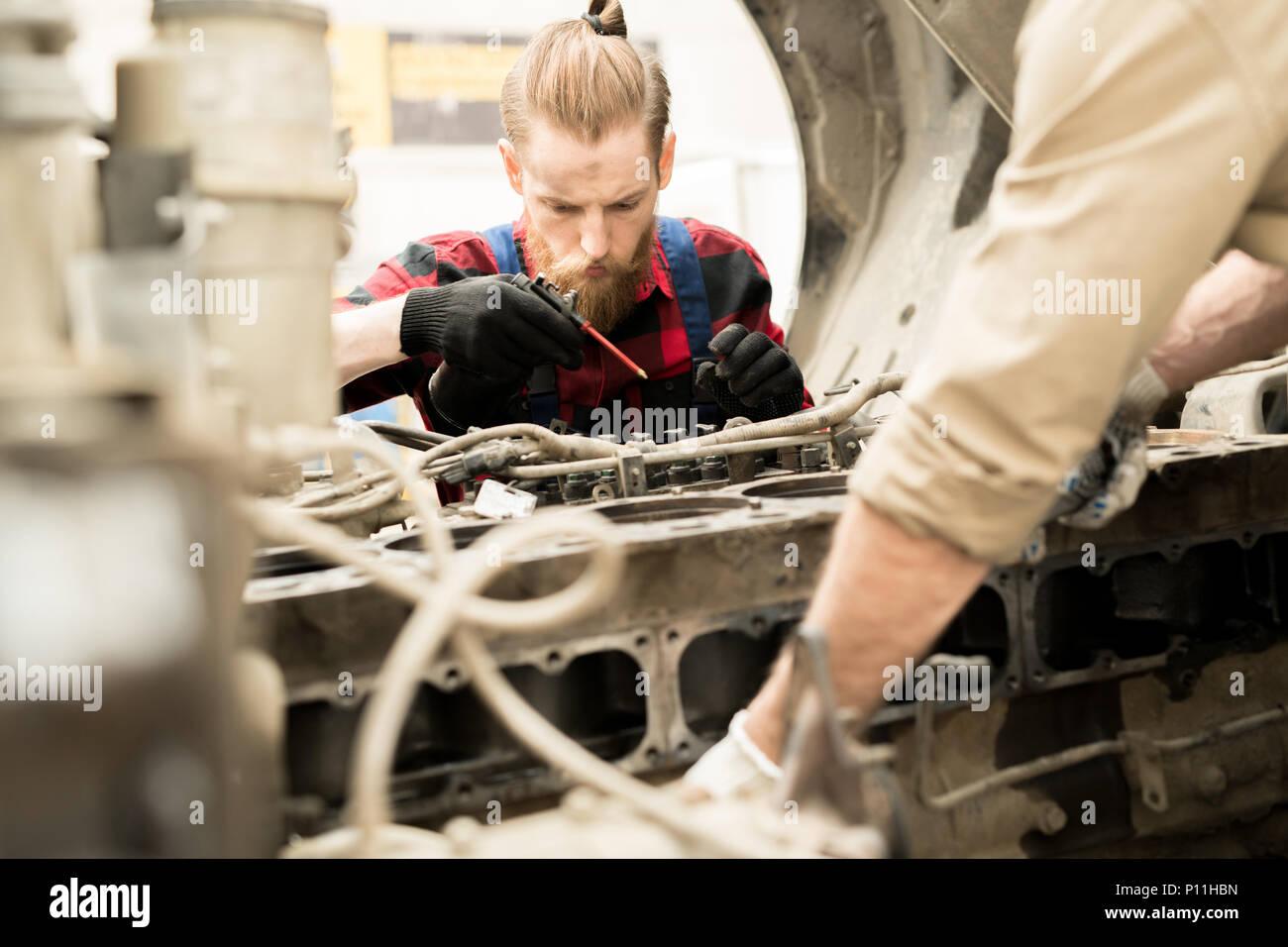 Mechanic Repairing Vehicle - Stock Image