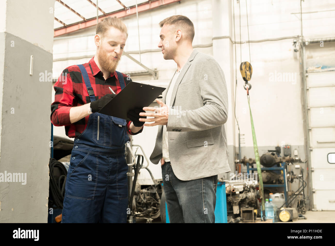 Car Technician Talking To Client - Stock Image