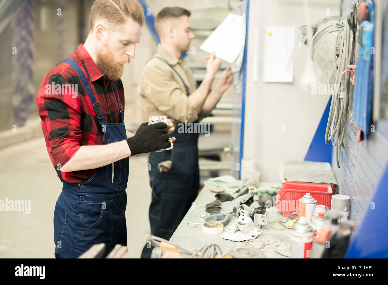 Mechanics Working In Repair Shop - Stock Image