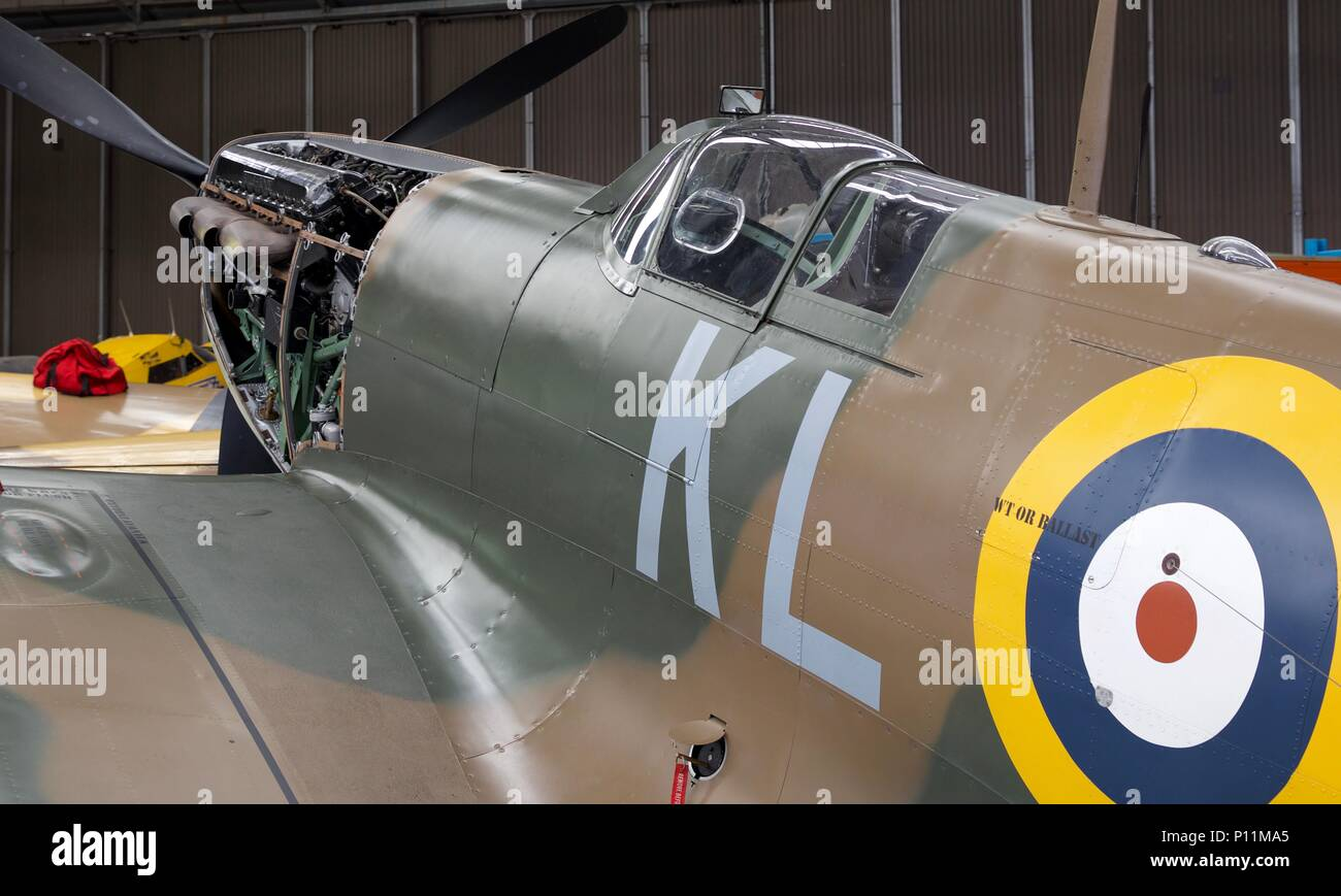 Supermarine Spitfire Ia 'X4650 / KL-A' undergoing maintenance at the Imperial War Museum at Duxford - Stock Image