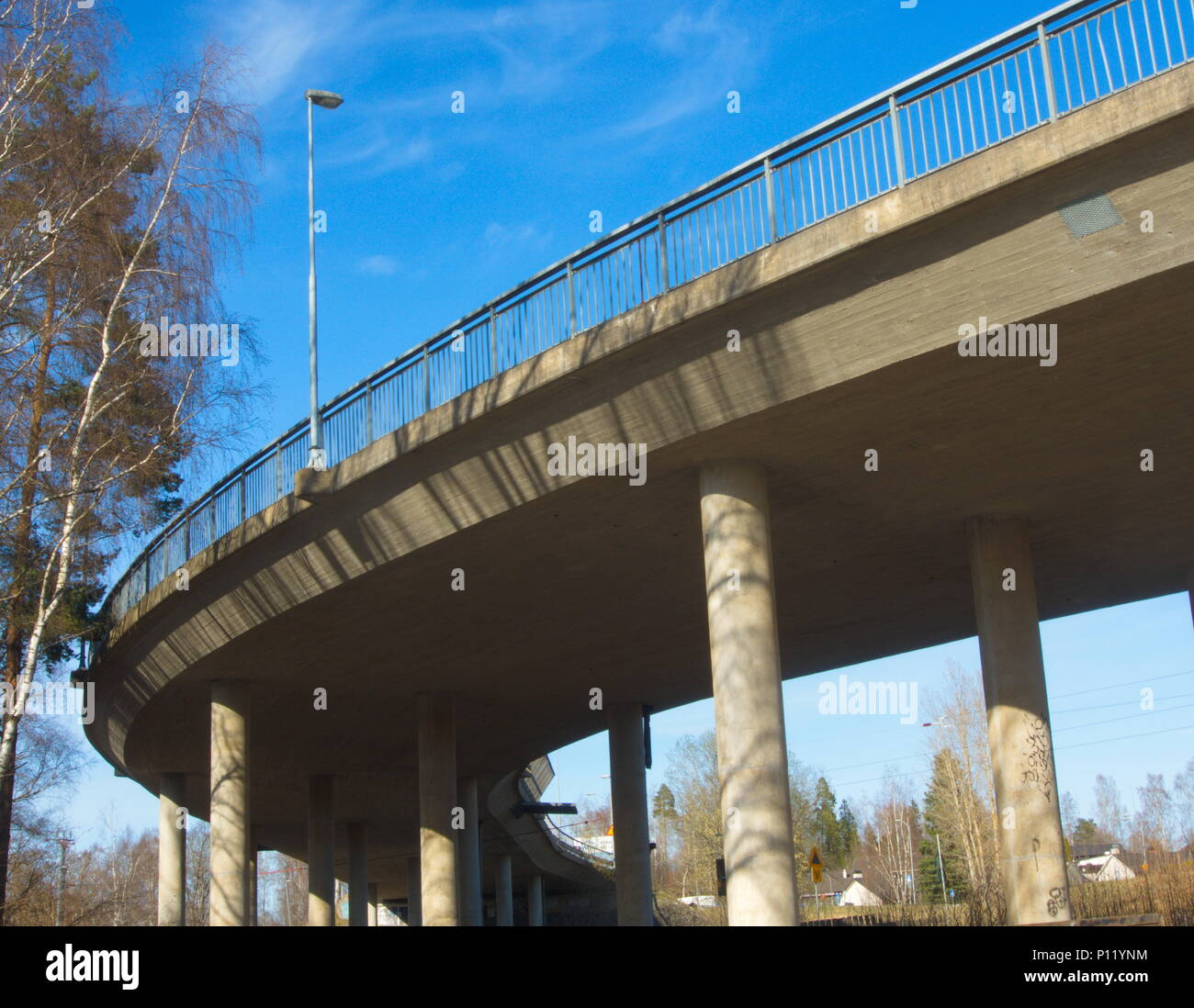 Concrete road bridge and a blue sky - Stock Image