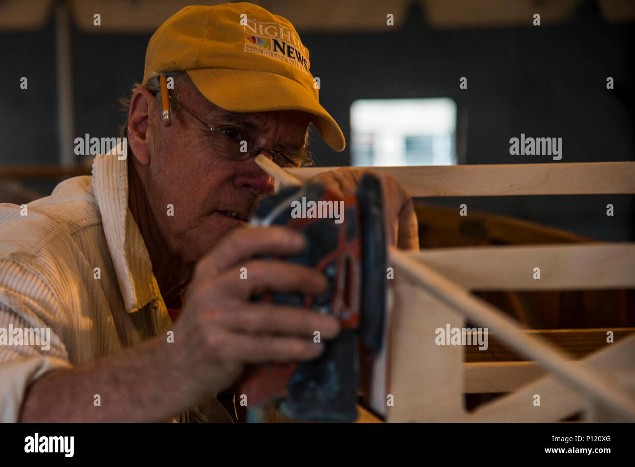 Dorian Walker, Chairman of Friends of Jenny, works on the frame of an aircraft, May, 4, 2017 at Bowling Green, Kentucky. The Curtiss JN-4 is possibly North America's most famous World War I aircraft. It was a twin-seat, student in front of instructor, dual-control biplane. Its tractor propeller and maneuverability made it ideal for initial pilot training. It was widely used during World War I to train begining pilots, with an estimated 95% of all trainees having flown a JN-4. Stock Photo