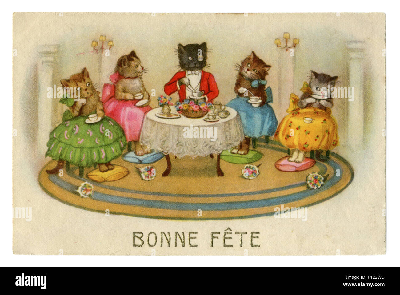 French historical postcard: Cats as people. Happy birthday! Tea party. Cat in a suit with a pince-nez and a girl kittens in colored skirts, France Stock Photo