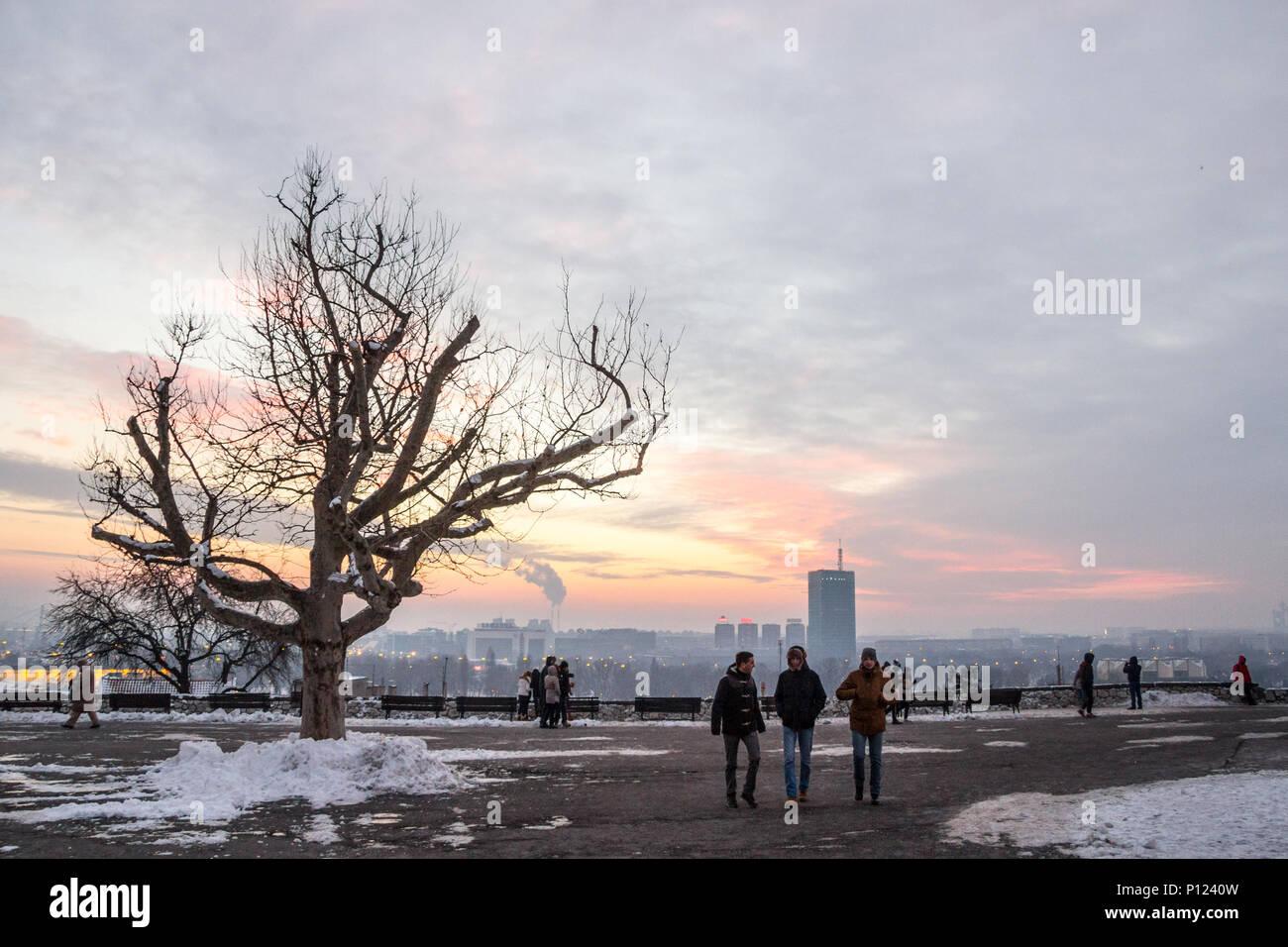 BELGRADE, SERBIA - JANUARY 1, 2015: people walking facing New Belgrade (Novi Beograd) from Kalemegdan fortress, one of the main monuments of Belgrade, - Stock Image