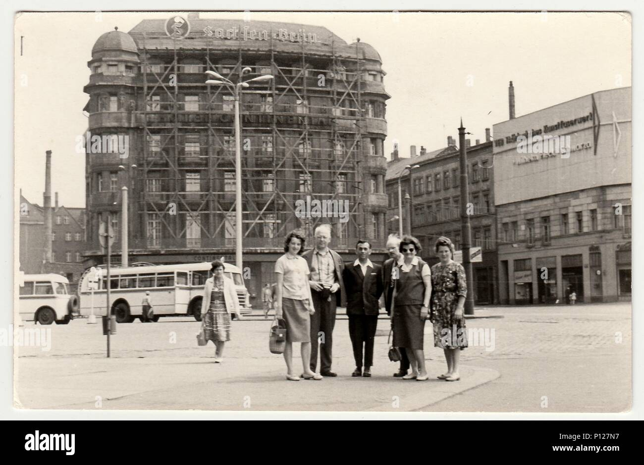 GERMANY - CIRCA 1960s: Vintage photo shows group of people in unknown town in Germany (GDR). Stock Photo
