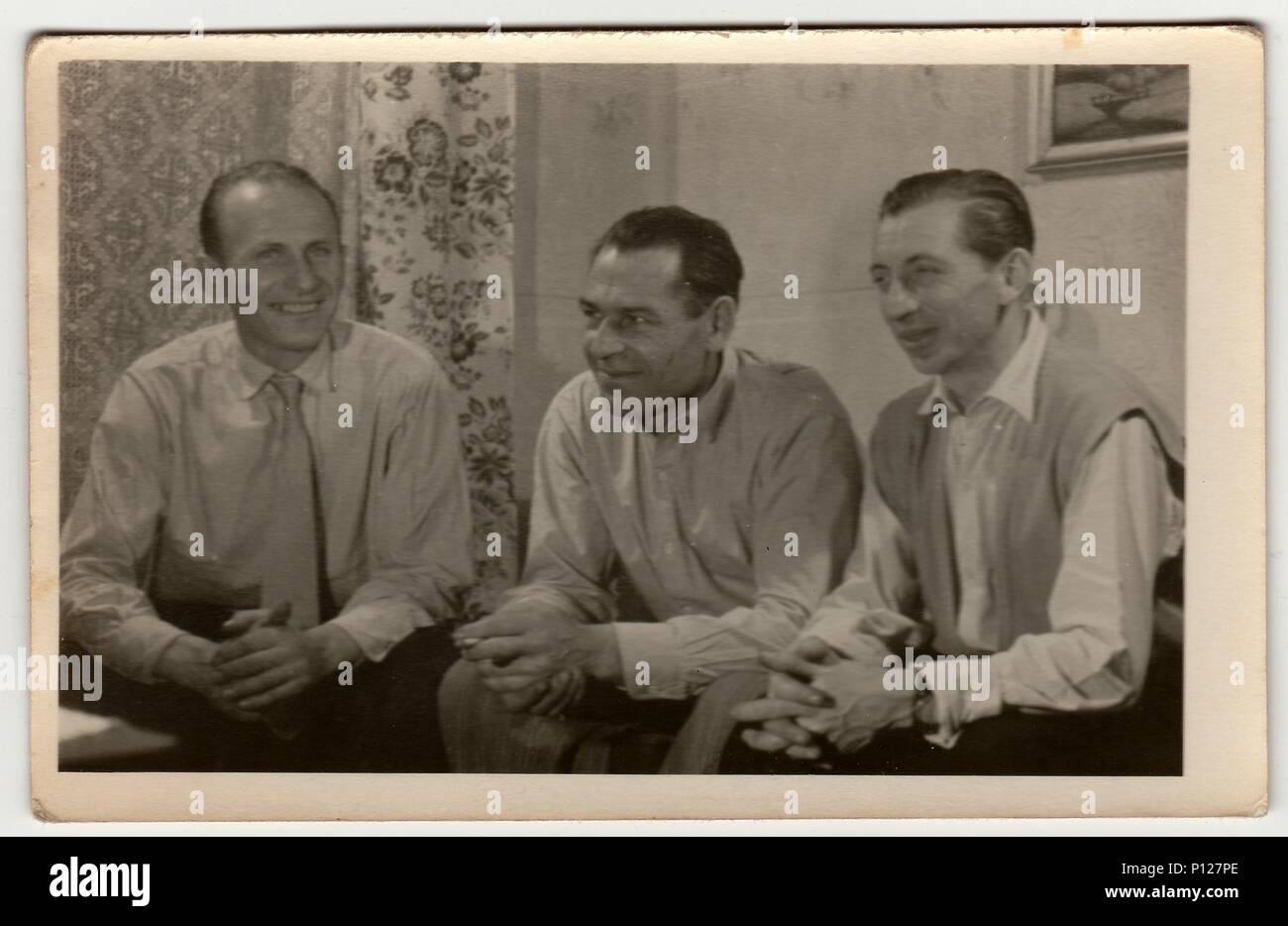 THE CZECHOSLOVAK SOCIALIST REPUBLIC - 1960s: Vintage photo shows men have a pleasant time at home. - Stock Image