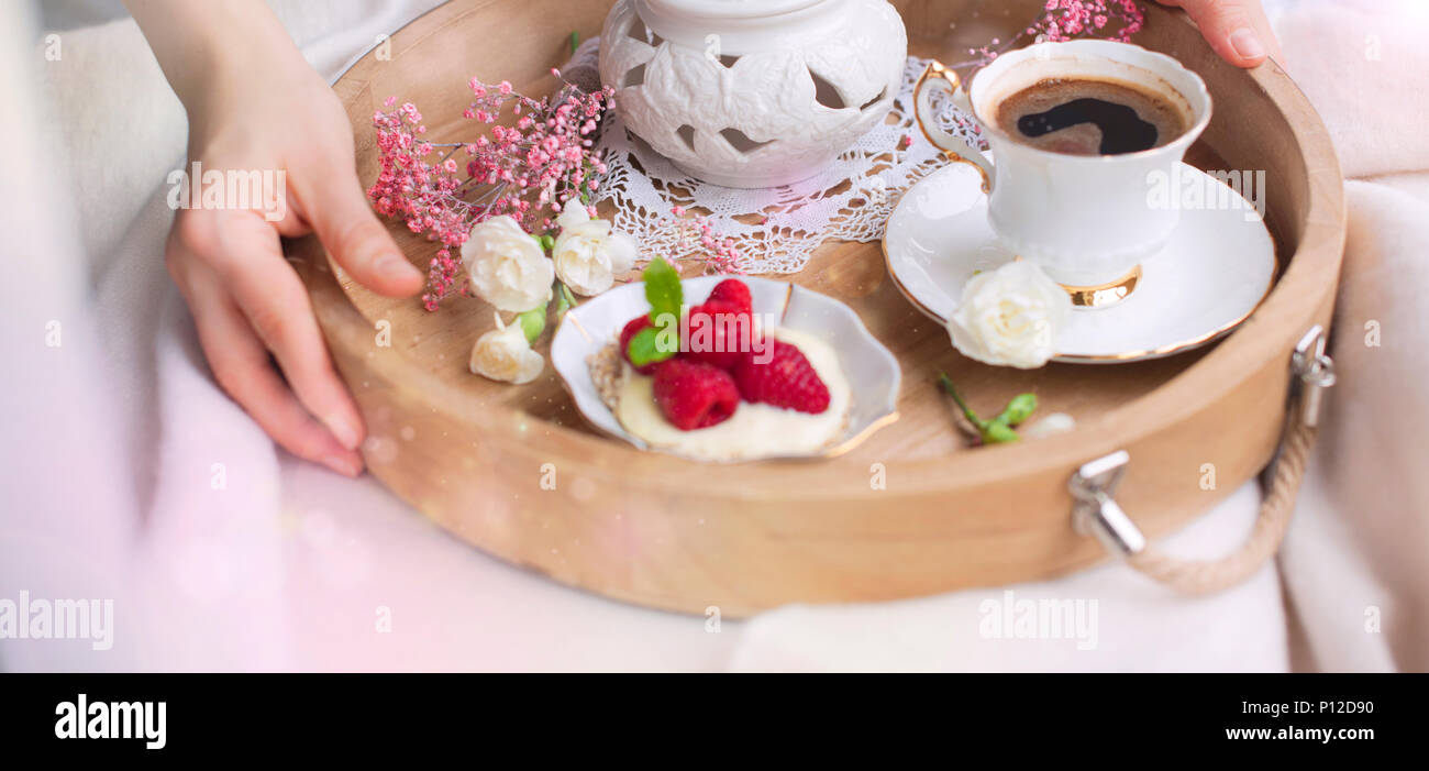 A Woman Is Drinking Coffee In Bed Wooden Tray With Breakfast Raspberry Berries And Flowers Light Colors Romance Good Morning Place For Text