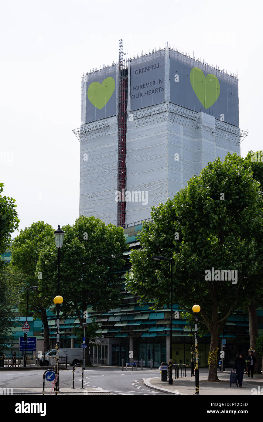 London, UK, 9yh Jun 2018 Daytime. Grenfell Tower, Scene of the disastrous fatal fire on the week of the first anniversary. The tower is noe covered - Stock Image